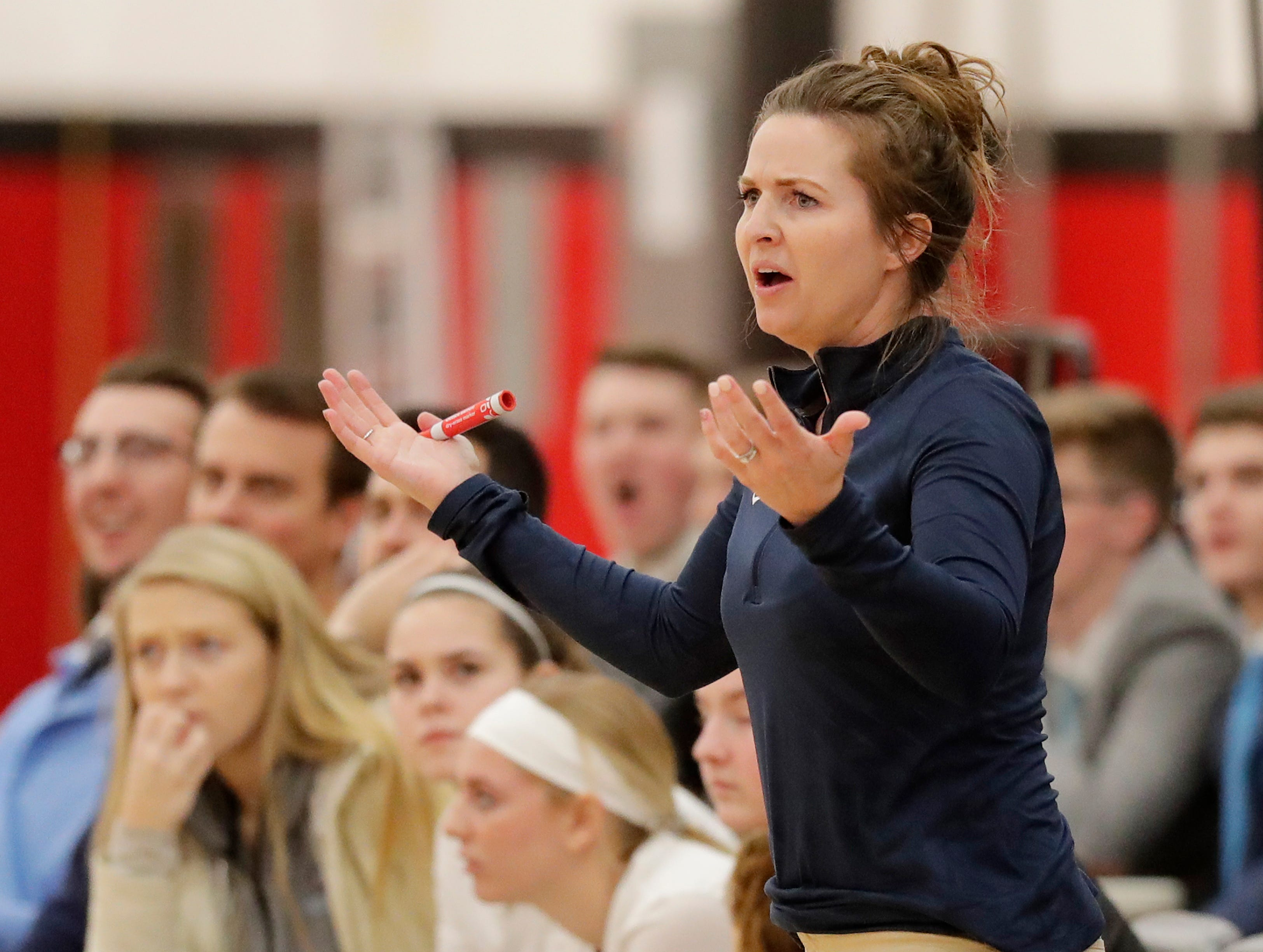 Bay Port head coach Kati Coleman reacts during a girls basketball game at Pulaski high school on Friday, January 4, 2019 in Pulaski, Wis.
