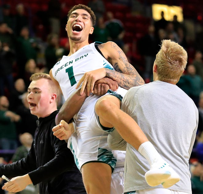 UWGB senior guard Sandy Cohen III (1) celebrates after hitting a buzzer beater to defeat Cleveland State at the Resch Center on Saturday.