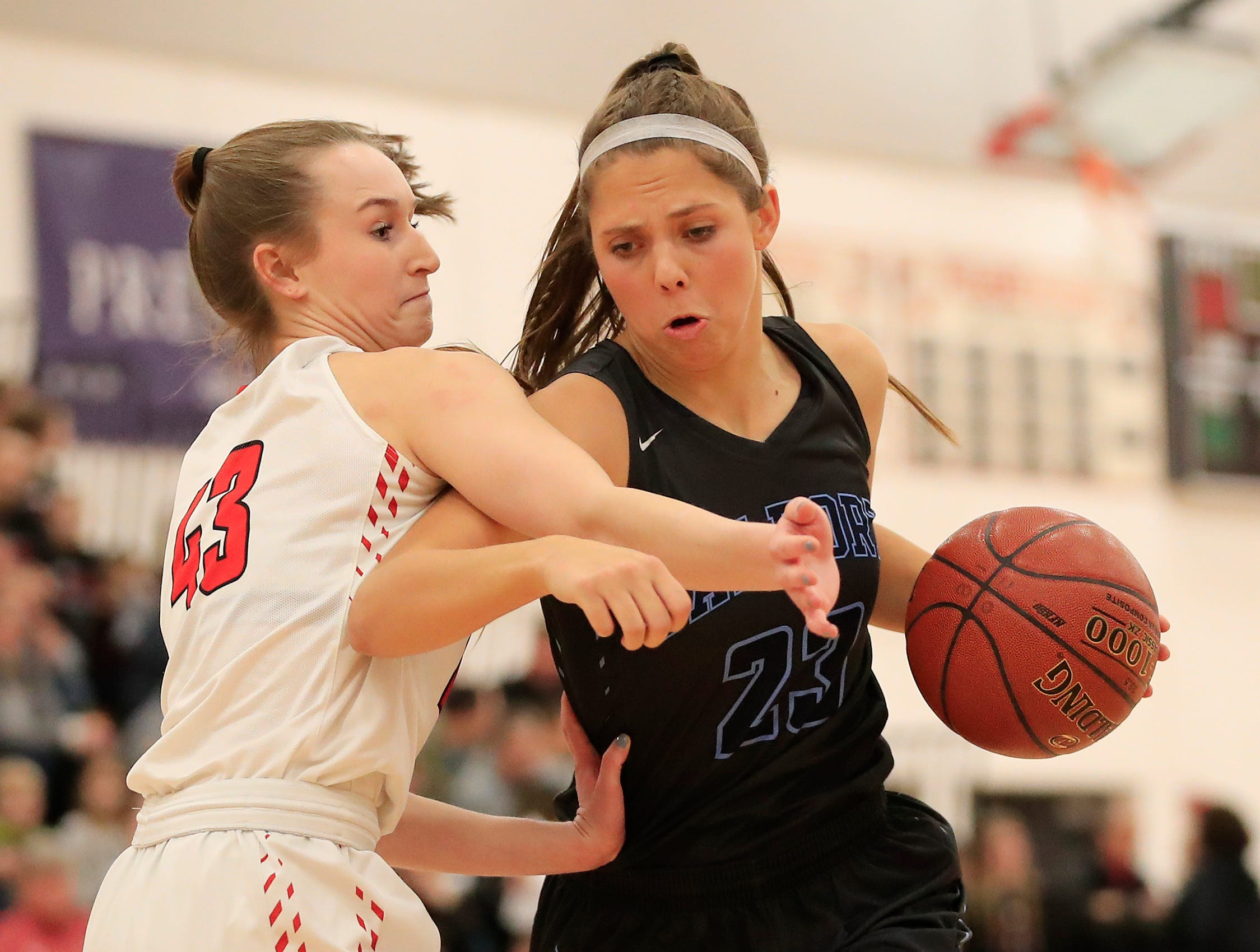 Bay Port's Emma Nagel (23) dribbles against Pulaski's Paige Steinbrecher (43) in a girls basketball game at Pulaski high school on Friday, January 4, 2019 in Pulaski, Wis.