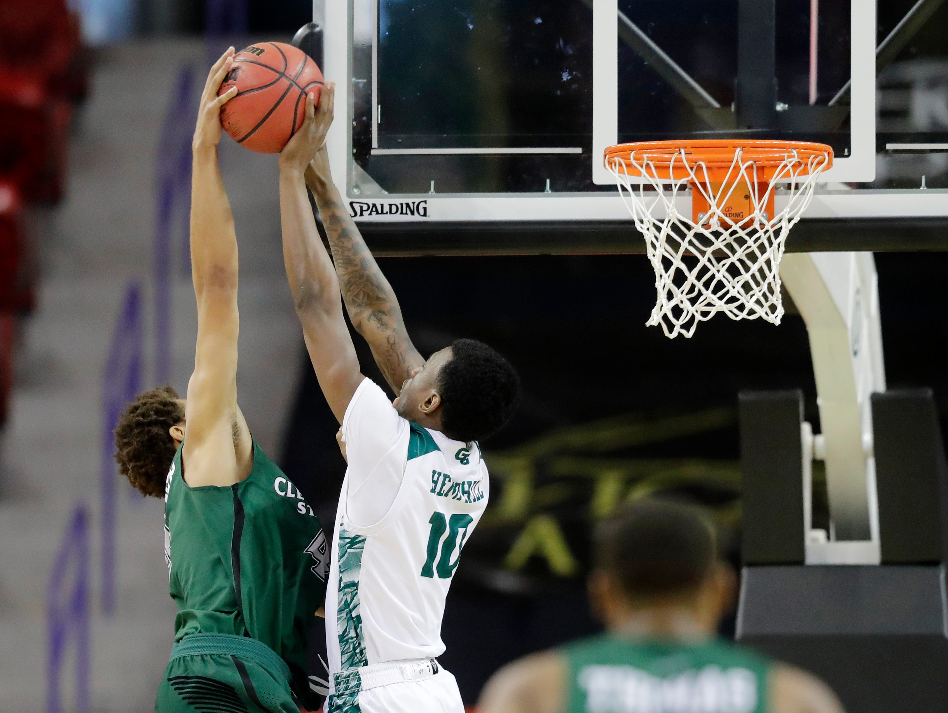 Green Bay Phoenix forward Shanquan Hemphill (10) blocks Cleveland State Vikings forward Seth Millner (4) in a Horizon League basketball game at the Resch Center on Saturday, January 5, 2019 in Green Bay, Wis.
