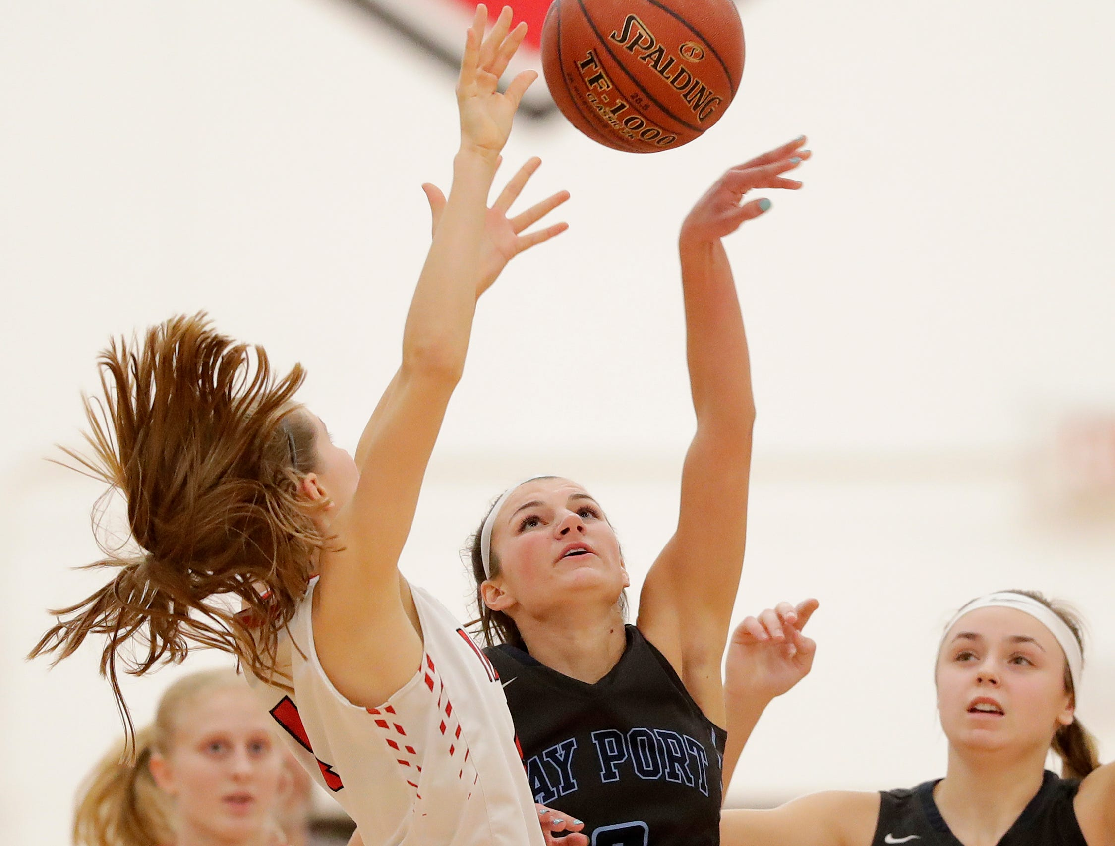 Bay Port's Grace Krause (2) blocks a shot by Pulaski's Sheridan Flauger (4) in a girls basketball game at Pulaski high school on Friday, January 4, 2019 in Pulaski, Wis.