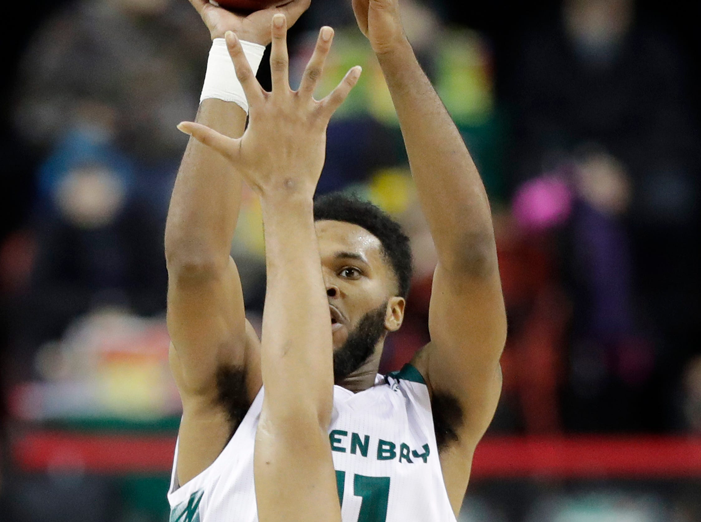 Green Bay Phoenix guard JayQuan McCloud (11) shoots against the Cleveland State Vikings in a Horizon League basketball game at the Resch Center on Saturday, January 5, 2019 in Green Bay, Wis.