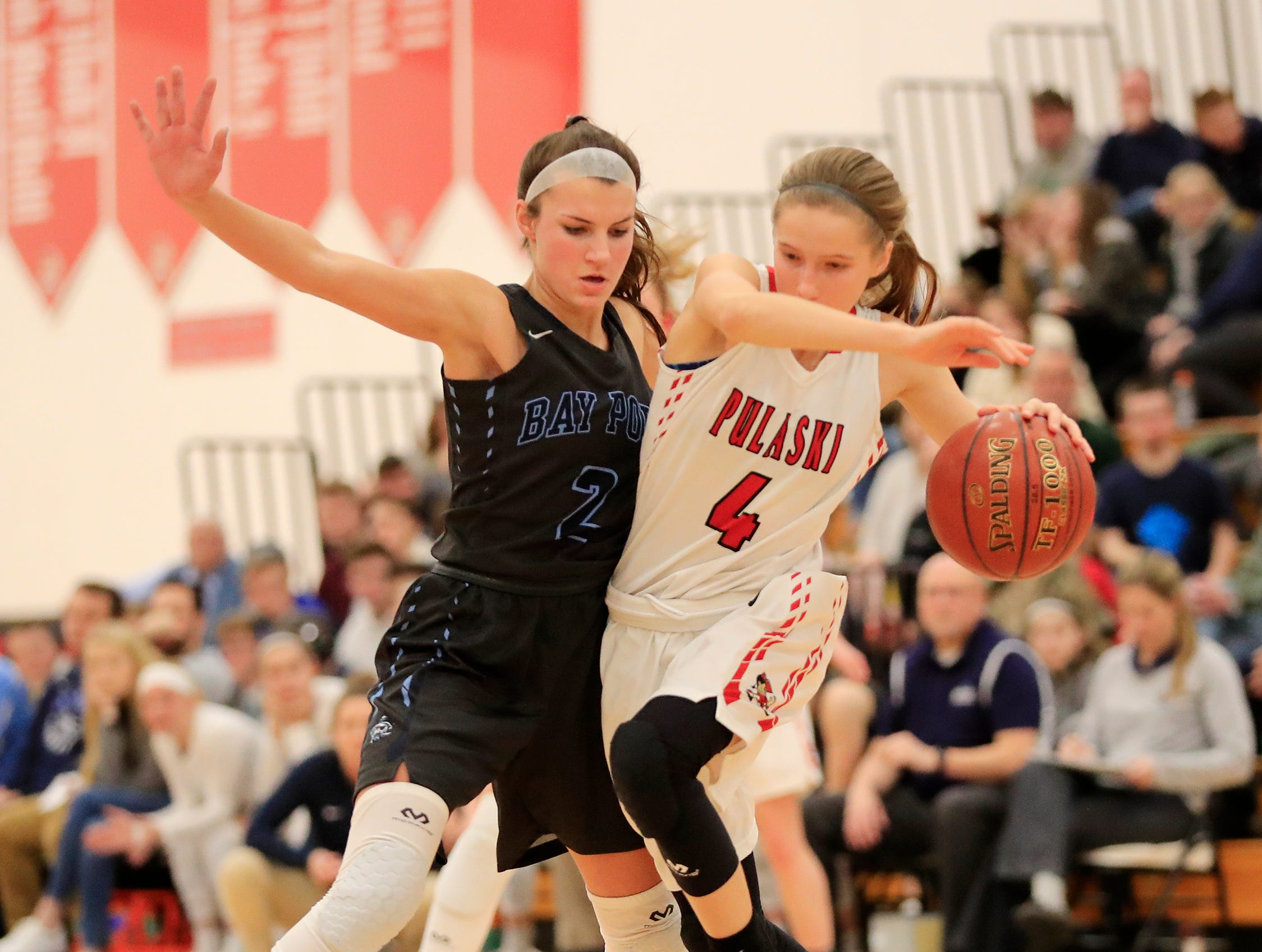 Bay Port's Grace Krause (2) guards Pulaski's Sheridan Flauger (4) in a girls basketball game at Pulaski high school on Friday, January 4, 2019 in Pulaski, Wis.