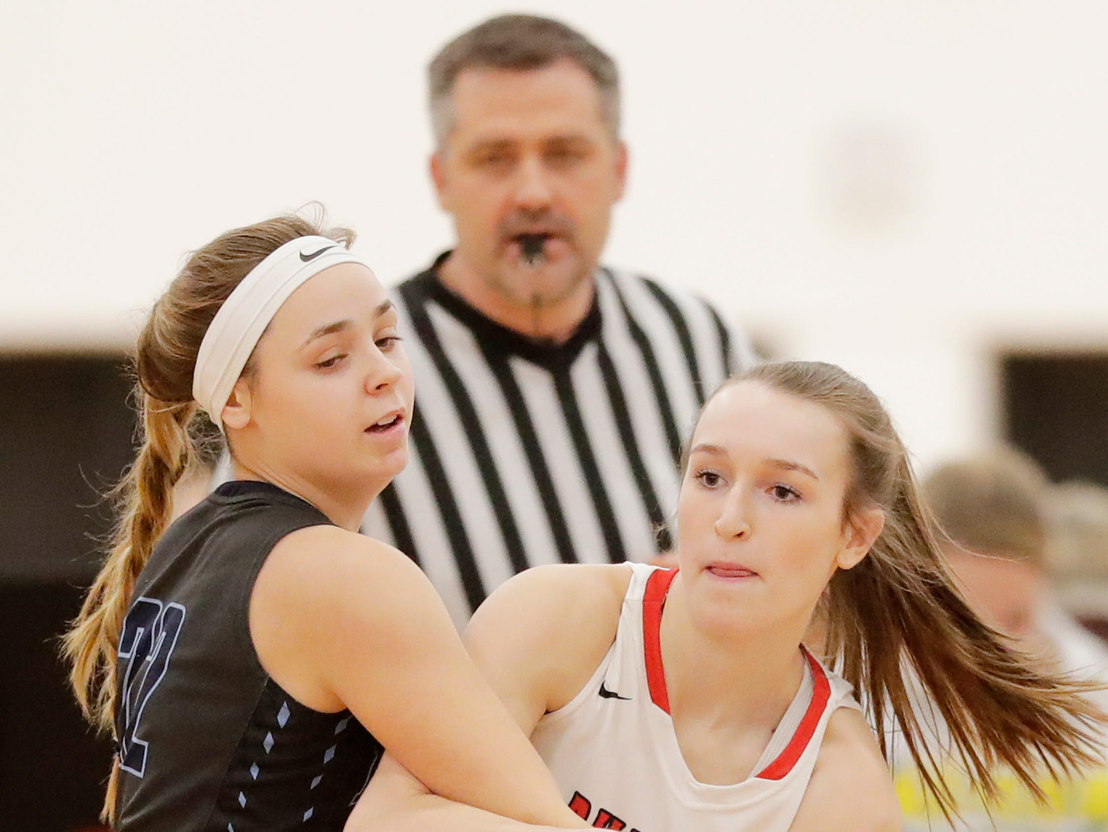 Bay Port's McKenzie Johnson (22) guards Pulaski's Paige Steinbrecher (43) in a girls basketball game at Pulaski high school on Friday, January 4, 2019 in Pulaski, Wis.