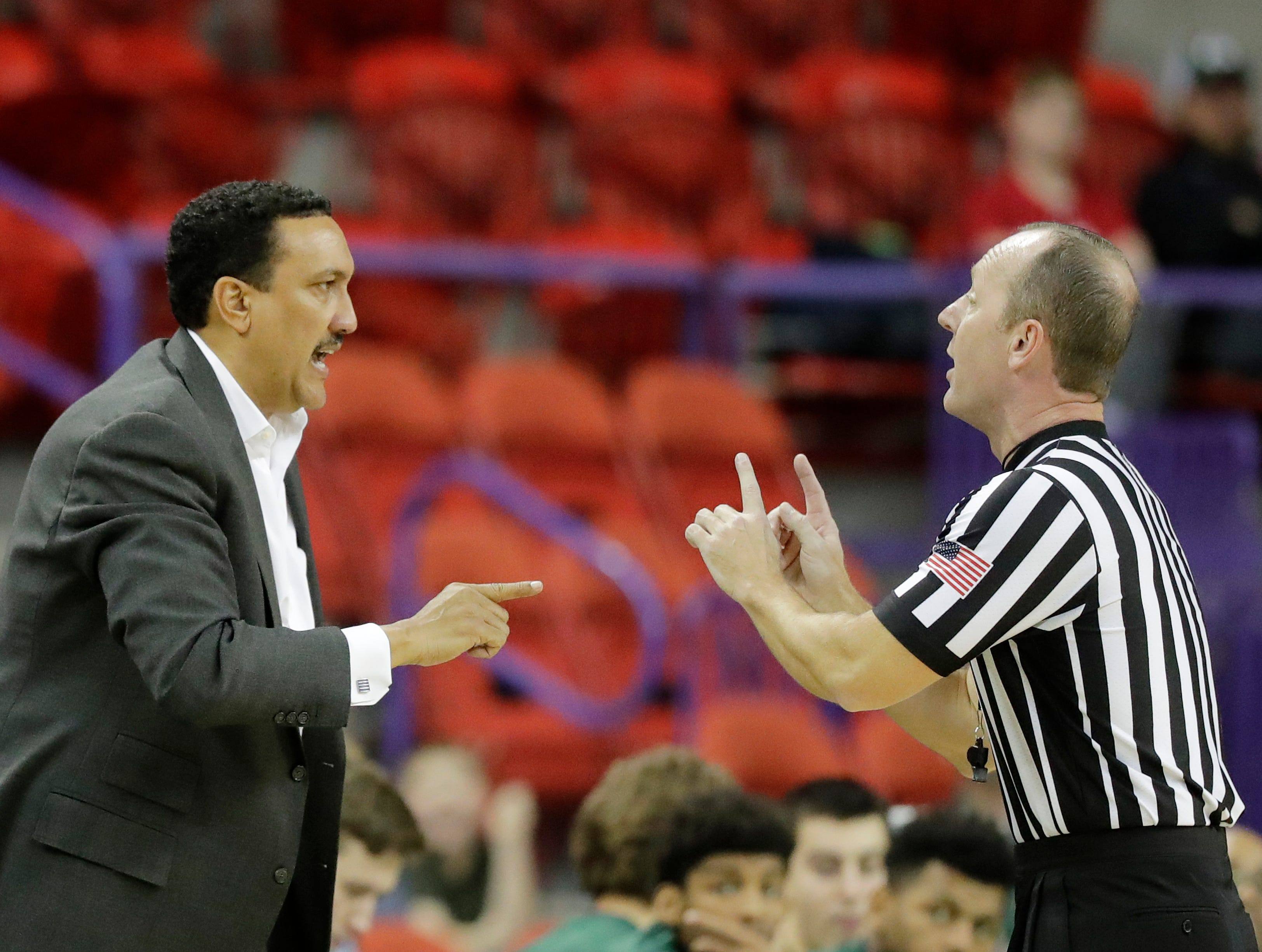 Cleveland State Vikings head coach Dennis Felton talks with a referee during a Horizon League basketball game at the Resch Center on Saturday, January 5, 2019 in Green Bay, Wis.
