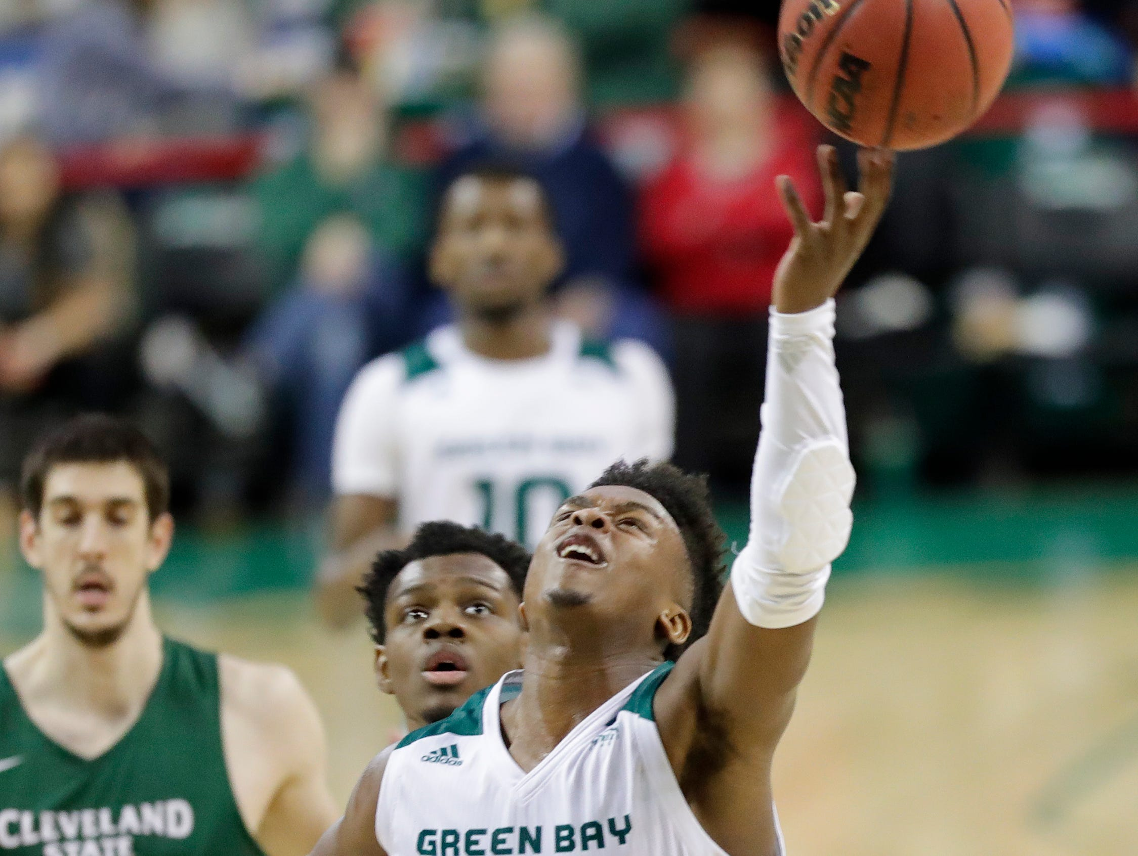 Green Bay Phoenix guard PJ Pipes (2) gets bumped out of bounds against the Cleveland State Vikings in a Horizon League basketball game at the Resch Center on Saturday, January 5, 2019 in Green Bay, Wis.