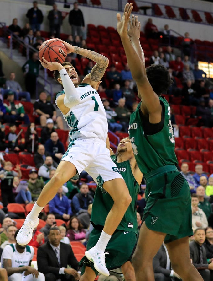 Green Bay Phoenix guard Sandy Cohen III (1) hits a jump shot at the buzzer to defeat the Cleveland State Vikings in a Horizon League basketball game at the Resch Center on Saturday, January 5, 2019 in Green Bay, Wis.