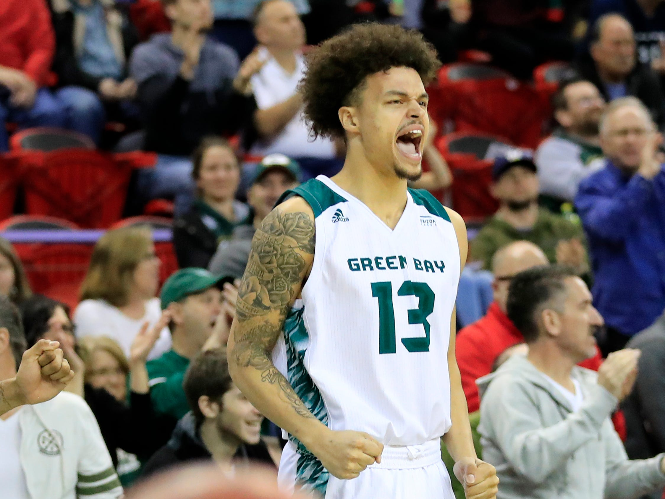 Green Bay Phoenix guard Trevian Bell (13) celebrates after a basket against the Cleveland State Vikings in a Horizon League basketball game at the Resch Center on Saturday, January 5, 2019 in Green Bay, Wis.