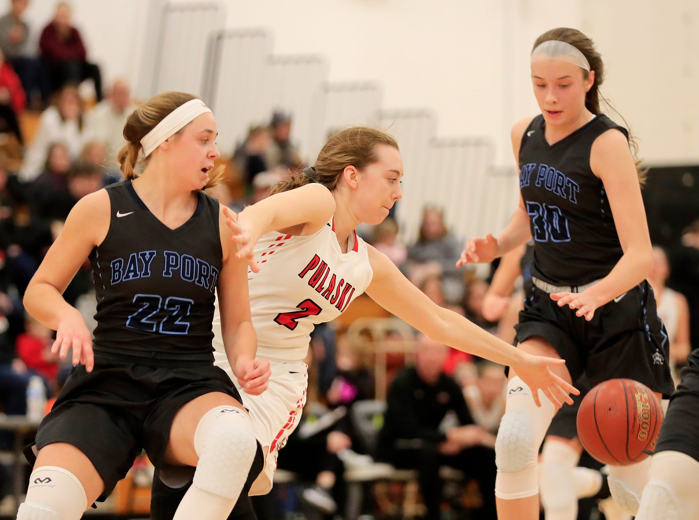 Pulaski's Isabel Majewski (2) loses control of the ball against Bay Port's McKenzie Johnson (22) in a girls basketball game at Pulaski high school on Friday, January 4, 2019 in Pulaski, Wis.