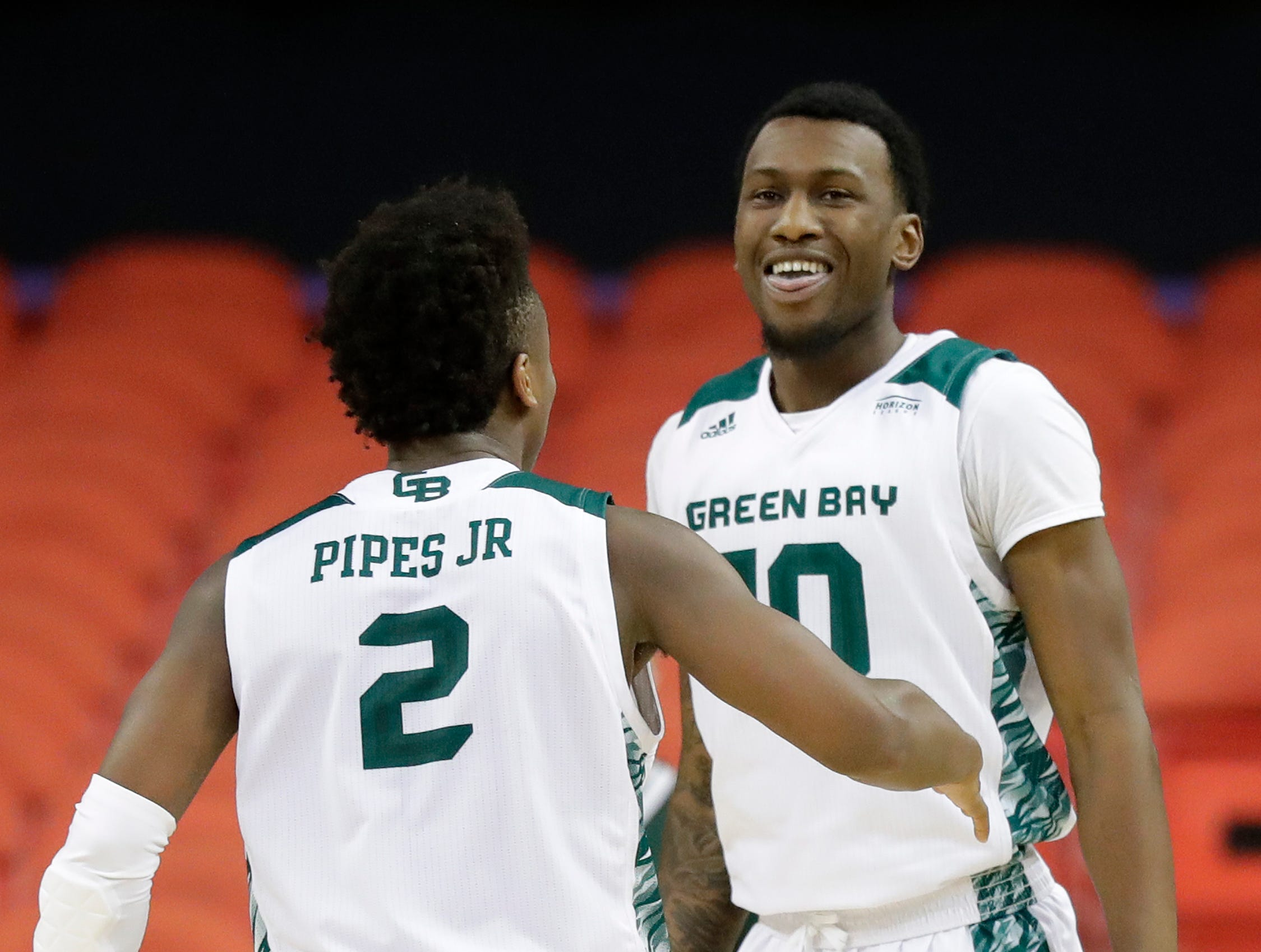 Green Bay Phoenix forward Shanquan Hemphill (10) celebrates after a block against the Cleveland State Vikings in a Horizon League basketball game at the Resch Center on Saturday, January 5, 2019 in Green Bay, Wis.