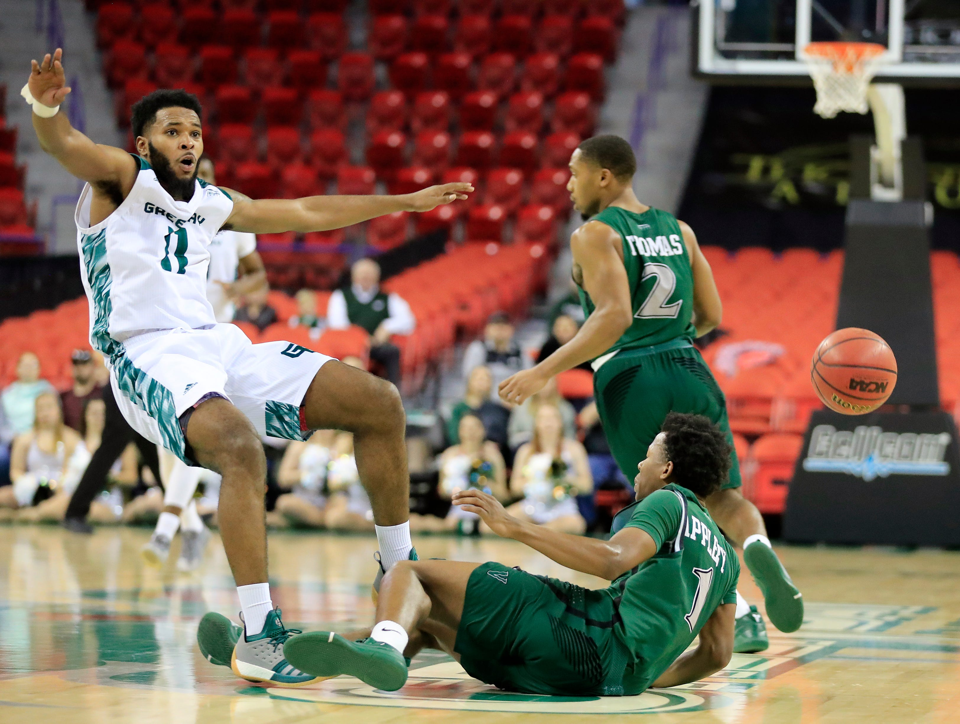 Green Bay Phoenix guard JayQuan McCloud (11) collides with Cleveland State Vikings guard Tyree Appleby (1) in a Horizon League basketball game at the Resch Center on Saturday, January 5, 2019 in Green Bay, Wis.