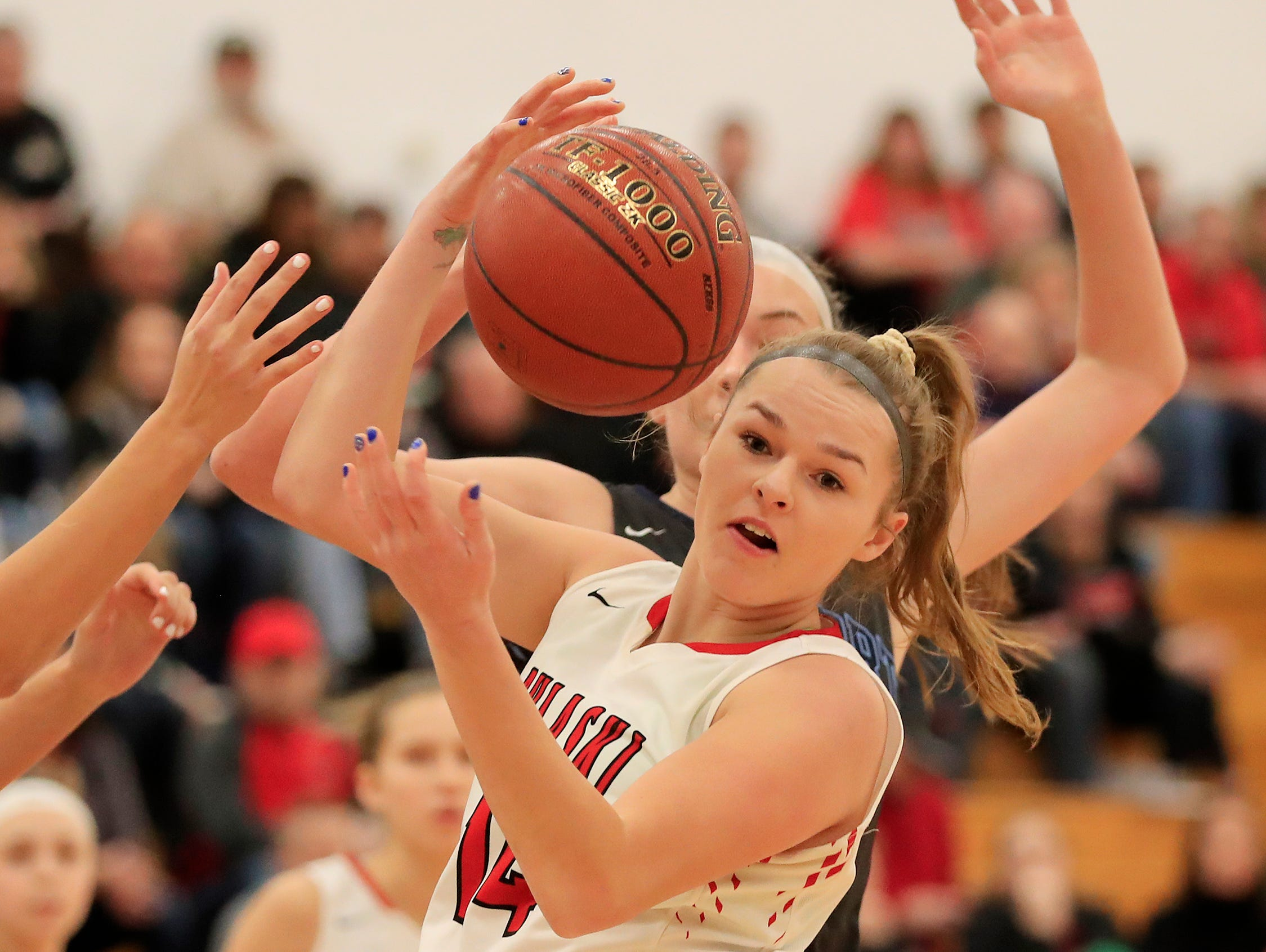 Pulaski's Maggie Hernandez (14) grabs a rebound against Bay Port in a girls basketball game at Pulaski high school on Friday, January 4, 2019 in Pulaski, Wis.
