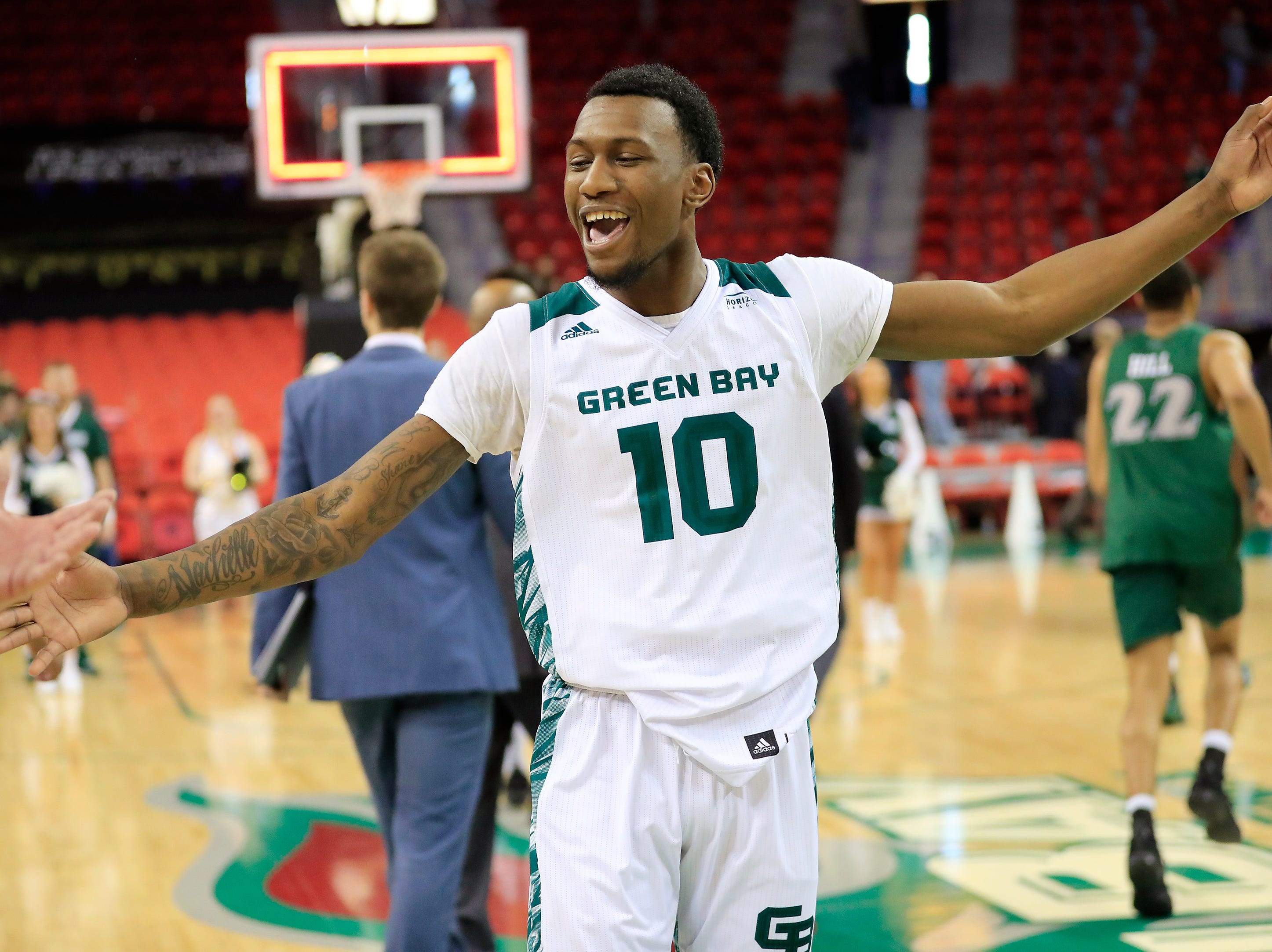 Green Bay Phoenix forward Shanquan Hemphill (10) celebrates as he runs off the court after the Phoenix defeated the Cleveland State Vikings in a Horizon League basketball game at the Resch Center on Saturday, January 5, 2019 in Green Bay, Wis.