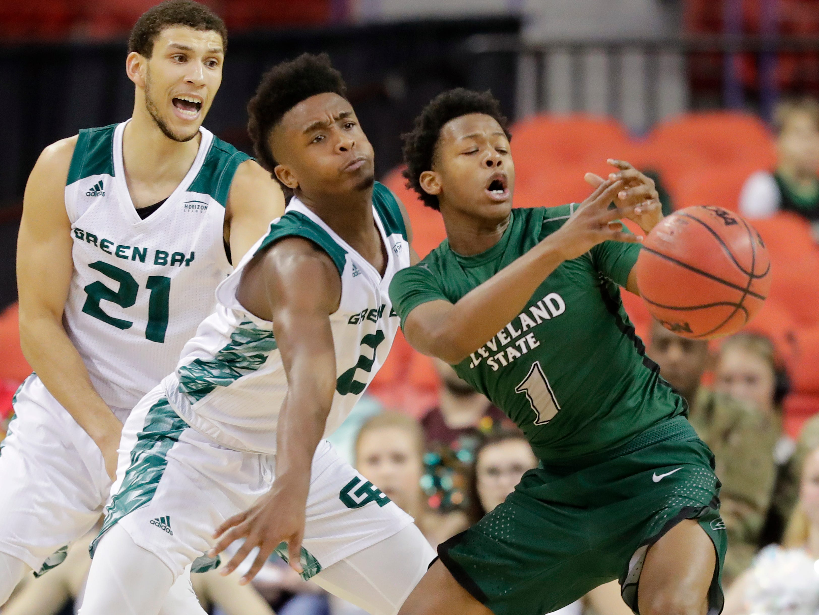 Green Bay Phoenix guard PJ Pipes (2) knocks th ball away from Cleveland State Vikings guard Tyree Appleby (1) in a Horizon League basketball game at the Resch Center on Saturday, January 5, 2019 in Green Bay, Wis.