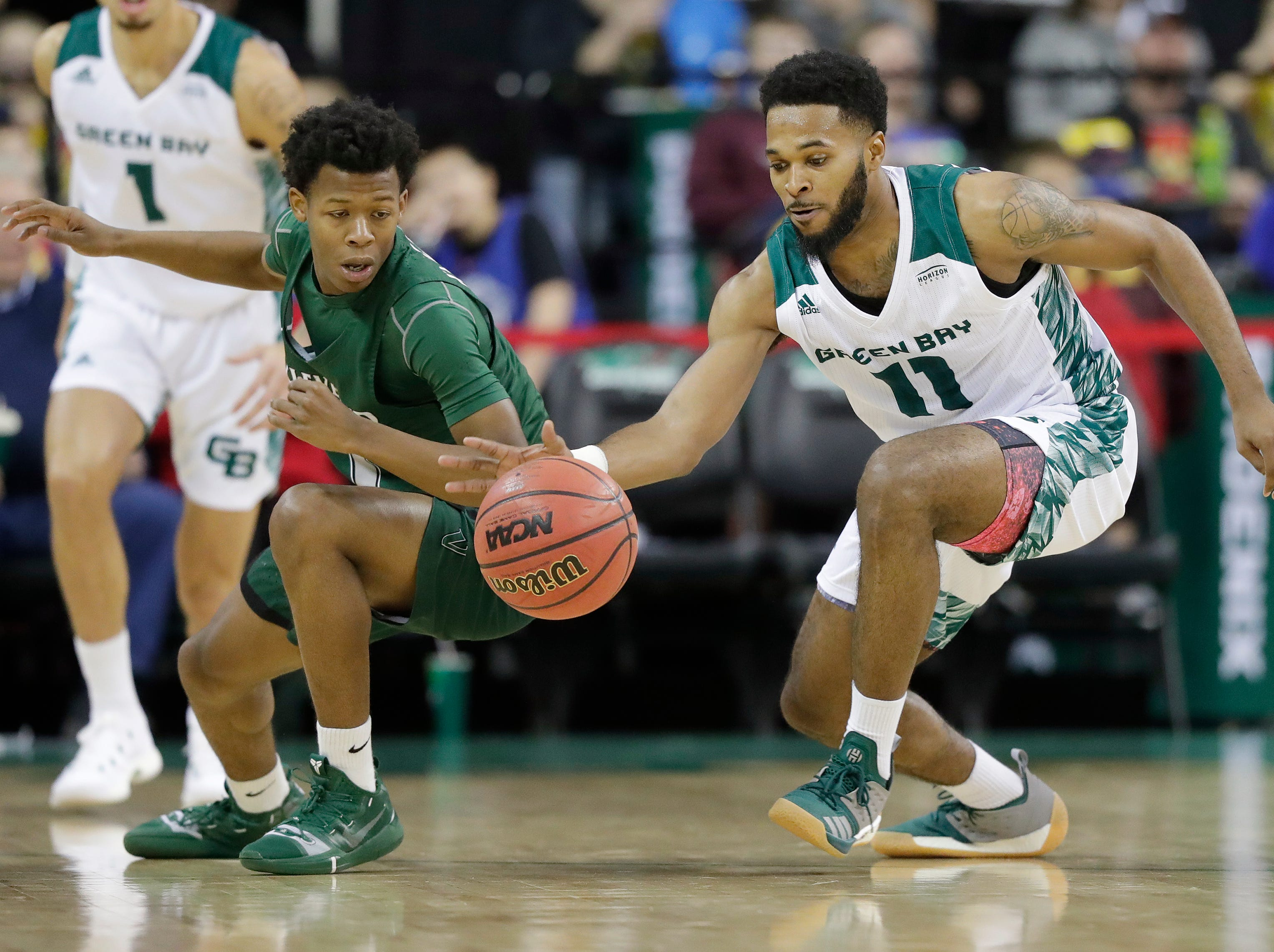 Green Bay Phoenix guard JayQuan McCloud (11) attempts a steal against Cleveland State Vikings guard Tyree Appleby (1) in a Horizon League basketball game at the Resch Center on Saturday, January 5, 2019 in Green Bay, Wis.