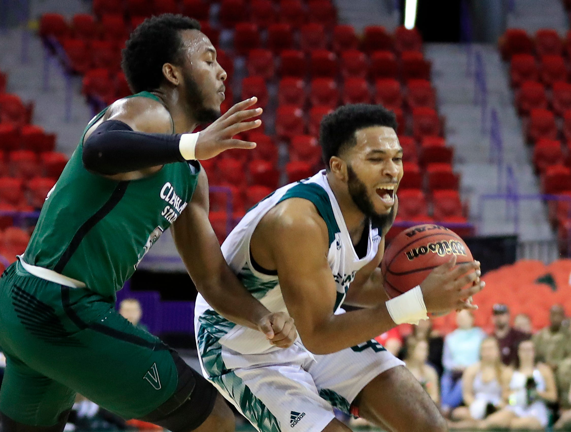 Green Bay Phoenix guard JayQuan McCloud (11) steals the ball from Cleveland State Vikings guard Rashad Williams (5) in a Horizon League basketball game at the Resch Center on Saturday, January 5, 2019 in Green Bay, Wis.