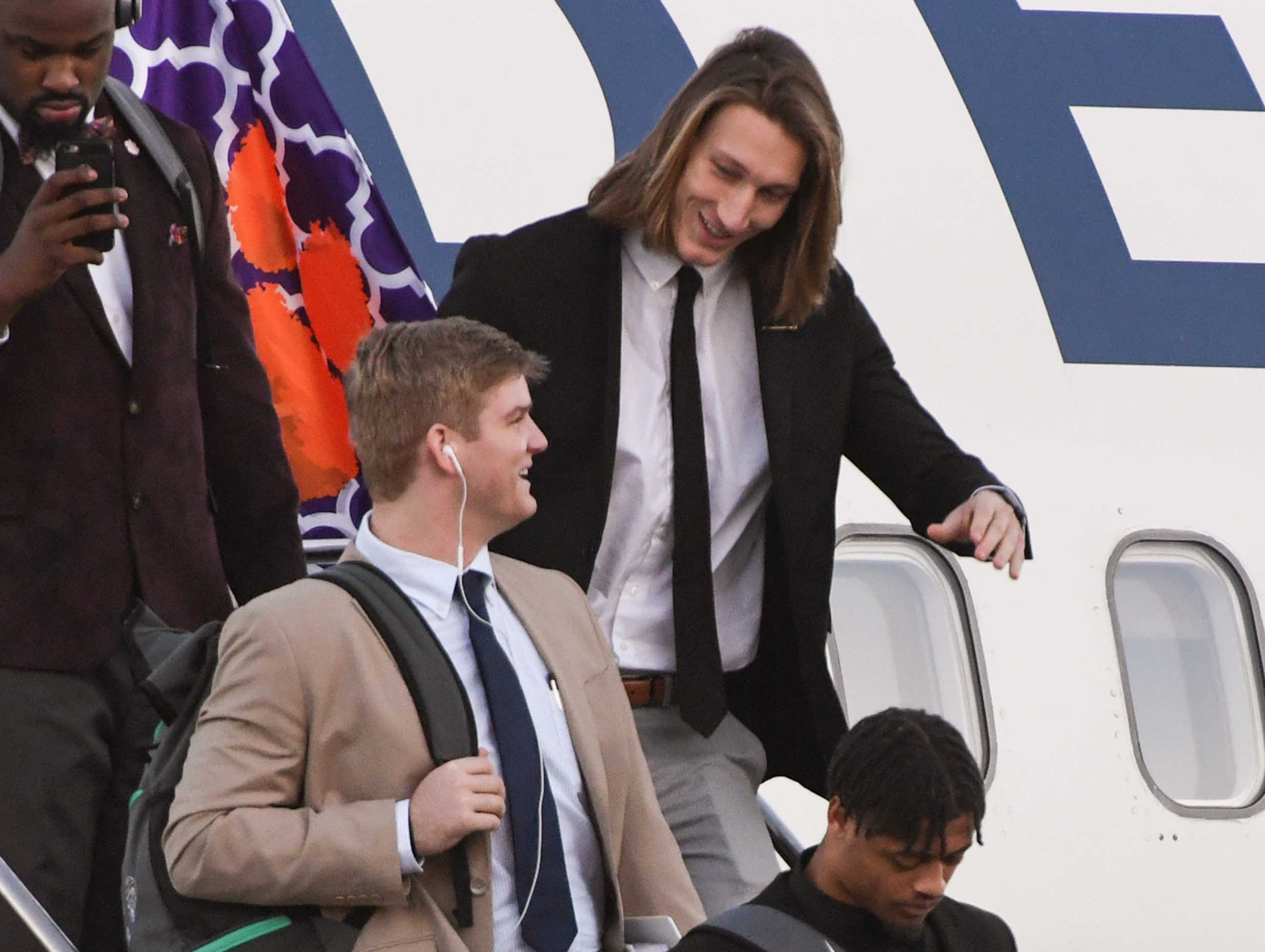 Clemson quarterbacks Chase Brice, left, and Trevor Lawrence arrive at San Jose International Airport in San Jose, California January 4, 2019.