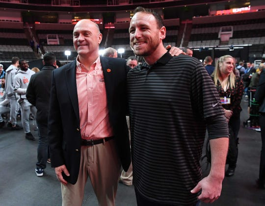 Clemson President Jim Clements, left, poses for a photo with Hot Dog eating champion Joey Chestnut of San Jose, during Media Day in the SAP Center in San Jose, California January 5, 2019.