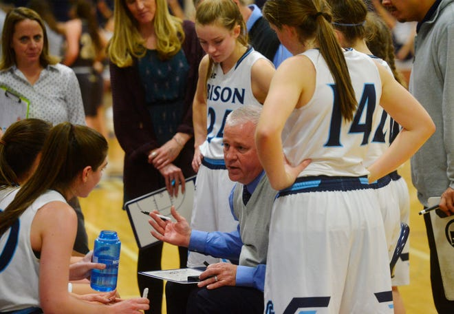 Great Falls High Girls' Basketball Coach Jerry Schmitz huddles with his team during Friday night's basketball game against Helena Capital in the Swarthout Fieldhouse.