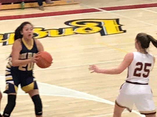 Box Elder's Lilly Gopher (20) looks for a passing lane around Fort Benton's Leah Gannon (25) in their District 9C battle in Fort Benton last January.