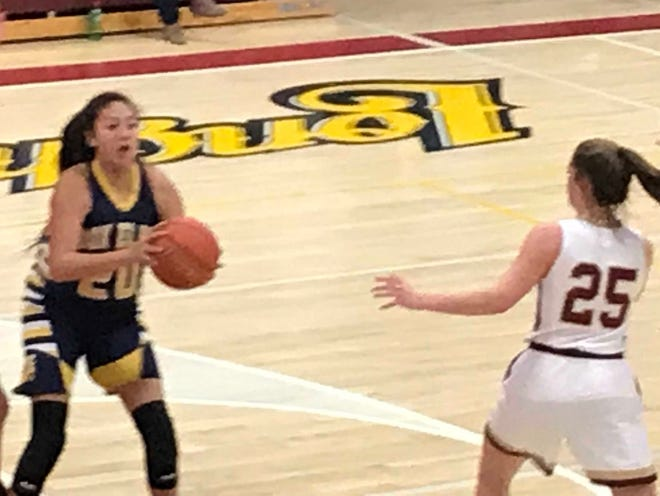 Box Elder's Lilly Gopher (20) looks for a passing lane around Fort Benton's Leah Gannon (25) in their District 9C battle Friday night at Fort Benton.