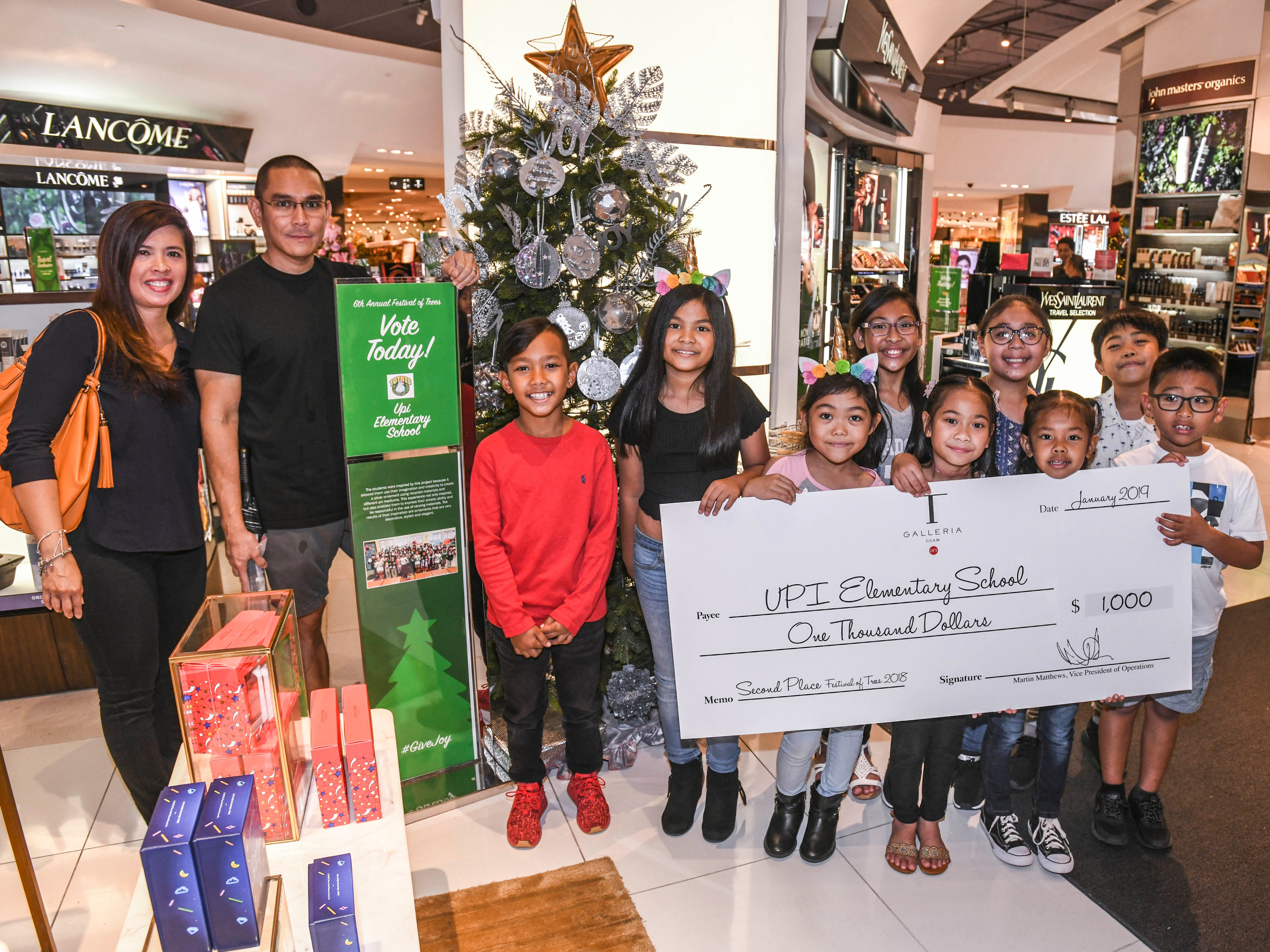 Upi Elementary School was announced as the second place winner and awarded $1,000 in the 6th annual Festival of Trees competition during a brief ceremony at the T Galleria by DFS in Tumon on Saturday, Jan. 5, 2019.