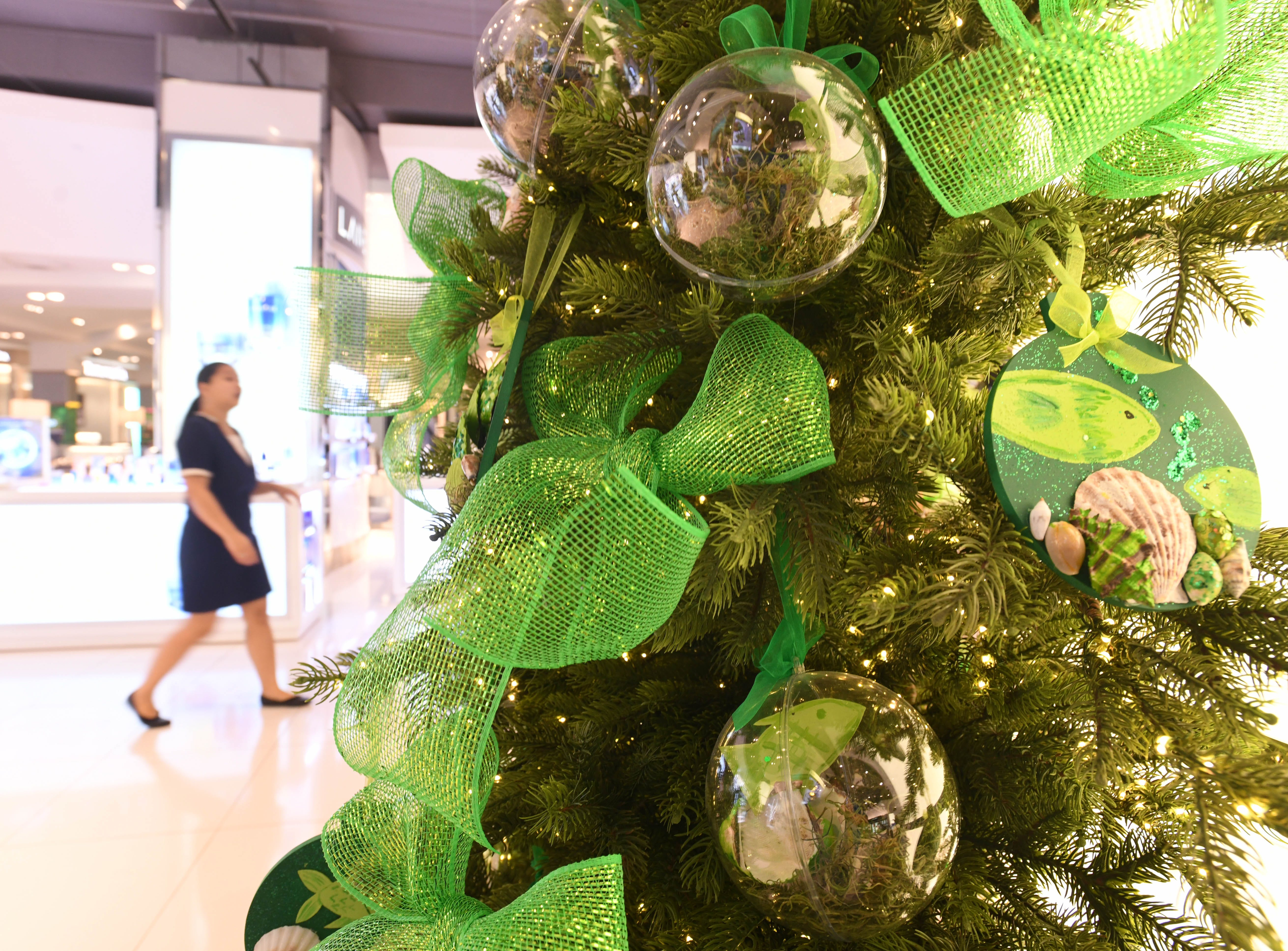 Green was the color scheme assigned to J.Q. San Miguel Elementary School for their Christmas decorated tree entered in the 6th annual Festival of Trees competition at the T Galleria by DFS in Tumon on Saturday, Jan. 5, 2019. The school placed first in the competition and was awarded $2,000 for their creativity in dressing up the tree with an eco-friendly message of keeping the island green.