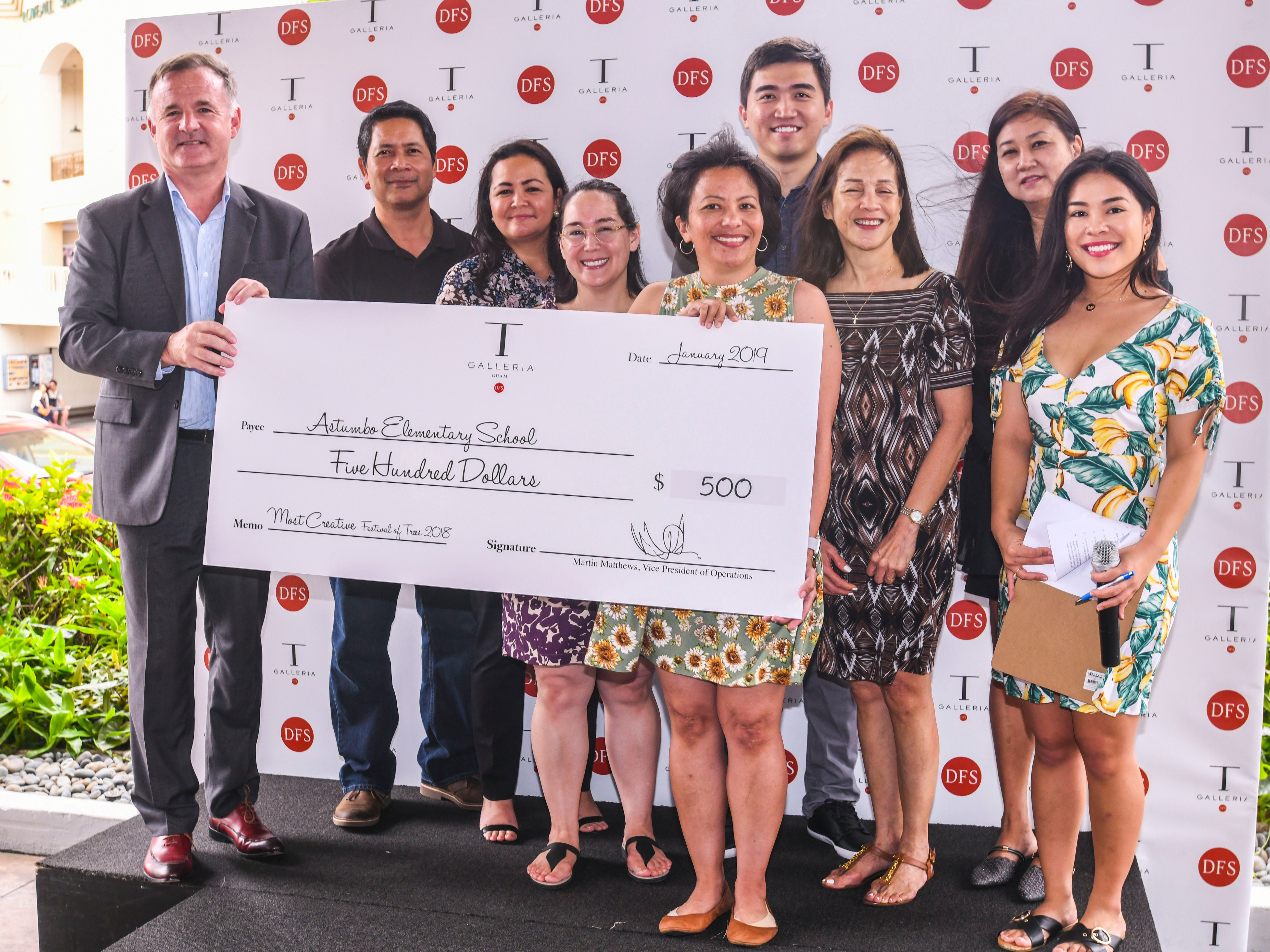 "Astumbo Elementary School was announced as the ""most creative"" entry and awarded $500 in the 6th annual Festival of Trees competition during a brief ceremony at the T Galleria by DFS in Tumon on Saturday, Jan. 5, 2019."