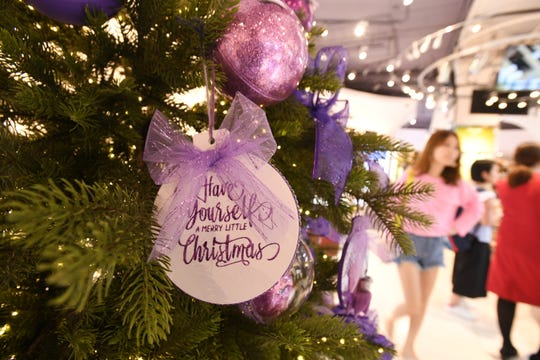 """Purple was the color scheme assigned to Merizo Martyrs Memorial School for their Christmas decorated tree entered in the 6th annual Festival of Trees competition at the T Galleria by DFS in Tumon on Saturday, Jan. 5, 2019. The school's tree entry was declare as the """"most creative"""" in the competition and was awarded $500."""