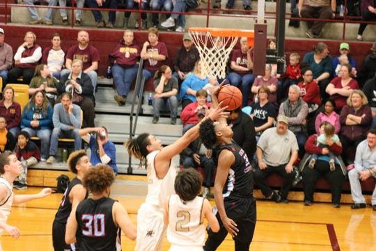 Iverson King blocks a Webster Co. goal on Friday against the Trojans.