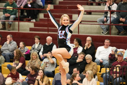 Bravette Alivia Thomas waves from the top of the cheer lift during the Webster Co. game.