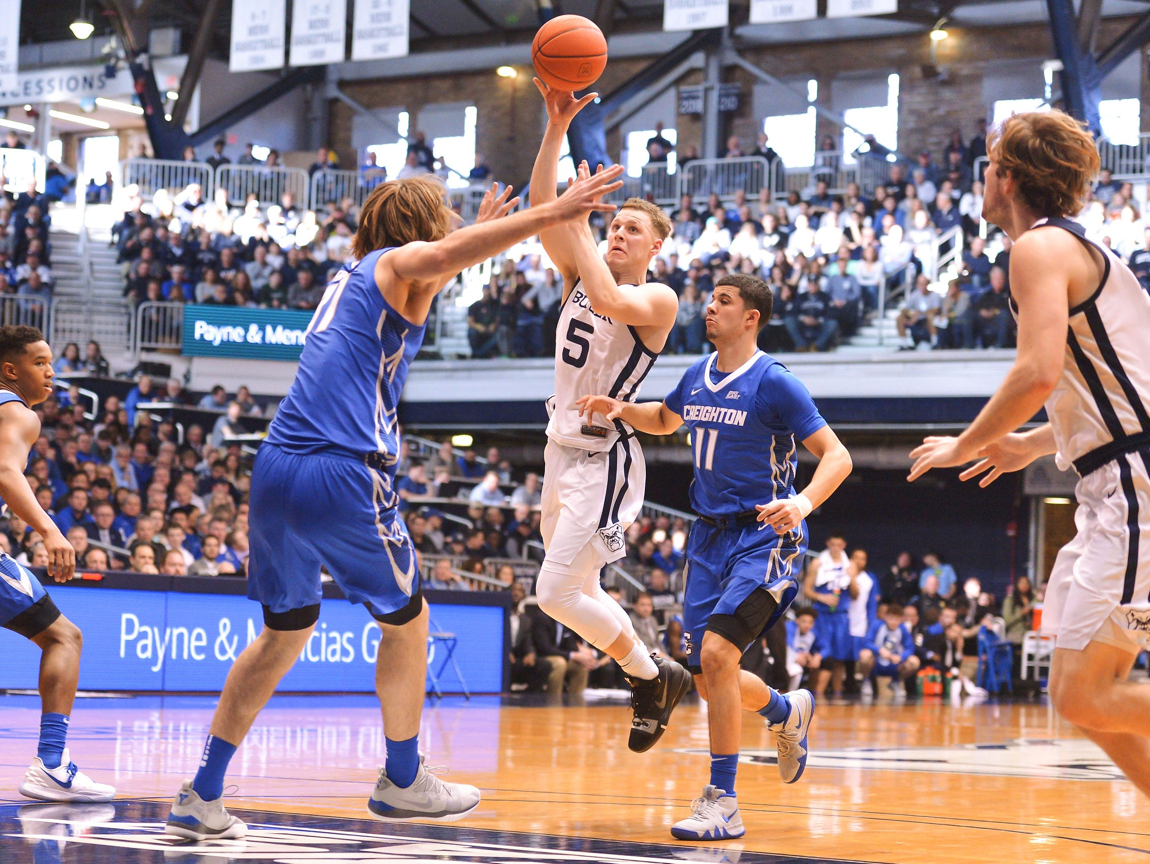 Butler Bulldogs guard Paul Jorgensen (5) scores over the Creighton Bluejays during the second half of game action between Butler University and Creighton University, at Hinkle Fieldhouse in Indianapolis, Indiana on Saturday, Jan. 5, 2019. The Butler Bulldogs defeated the Creighton Bluejays 84-69.