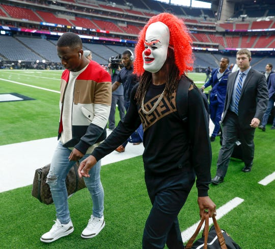 Indianapolis Colts wide receiver T.Y. Hilton (13) wore a clown mask as he and his teammates arrived at NRG Stadium in Houston, TX., on Saturday, Jan. 5, 2019.