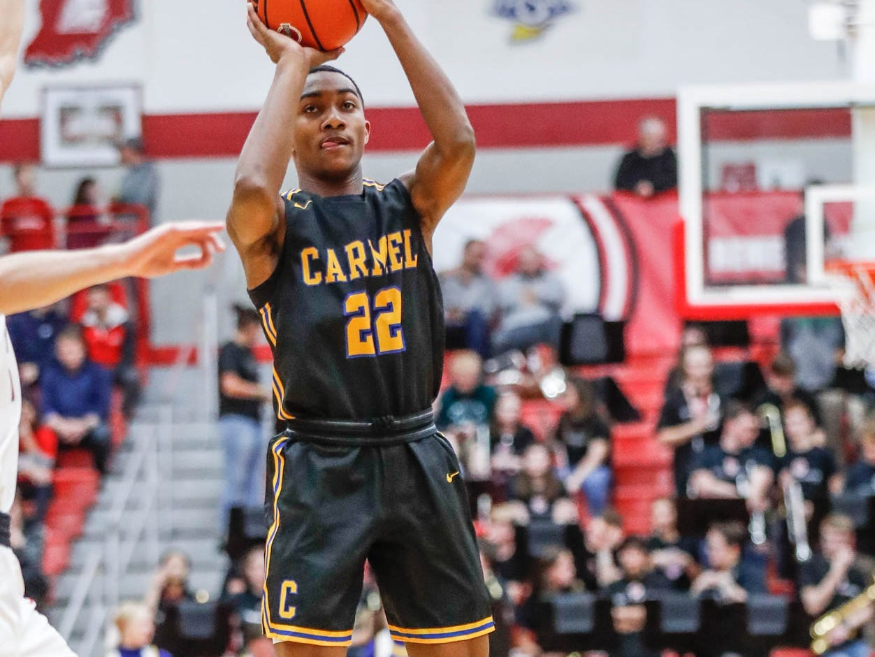 Carmel High School's guard Robert Fry (22) shoots a jump shot during a game between Center Grove High School and Carmel High School, held at Center Grove on on Friday, Jan. 4, 2019.