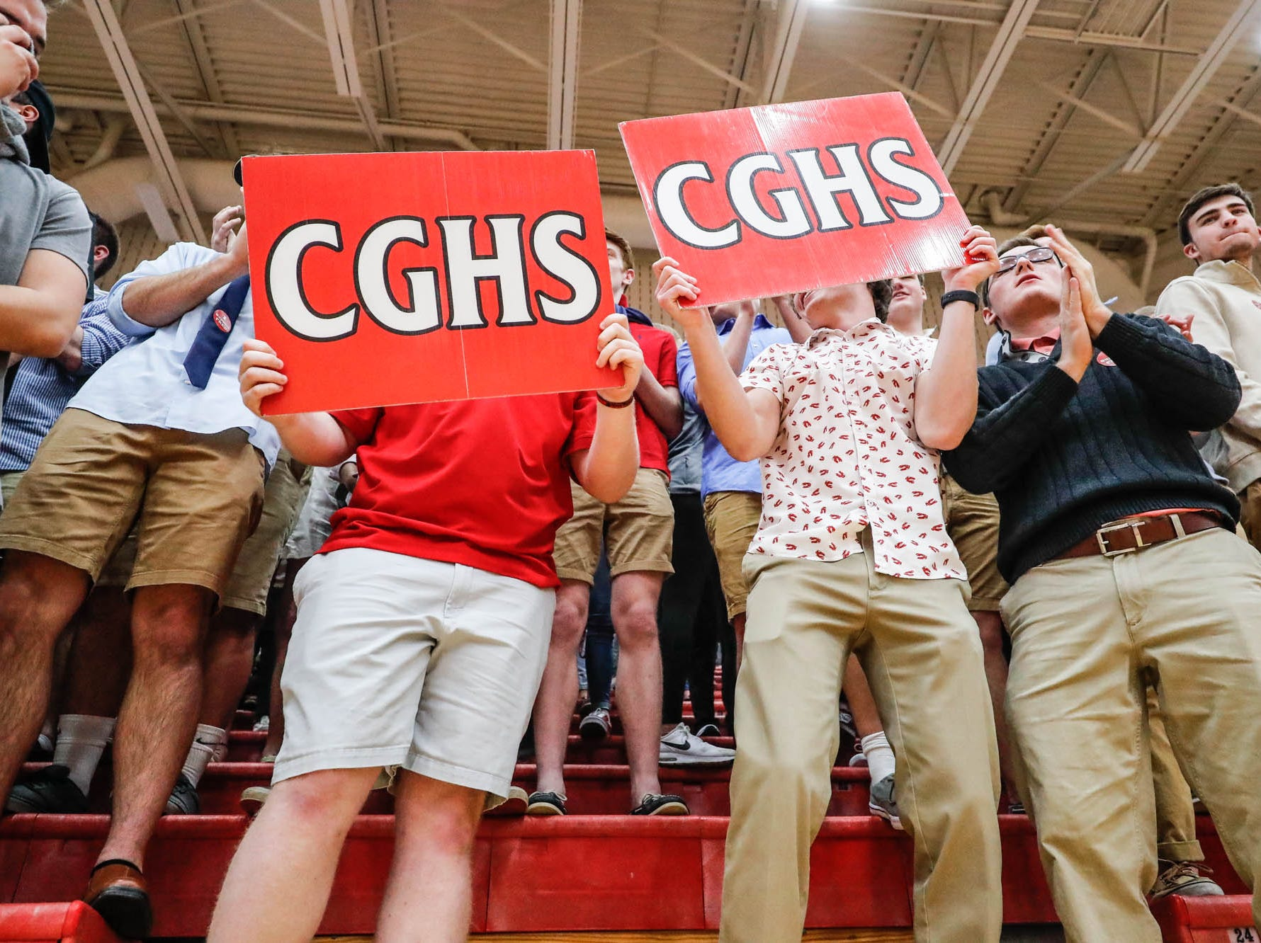 Students hold cheer signs during a game between Center Grove High School and Carmel High School, held at Center Grove on on Friday, Jan. 4, 2019.