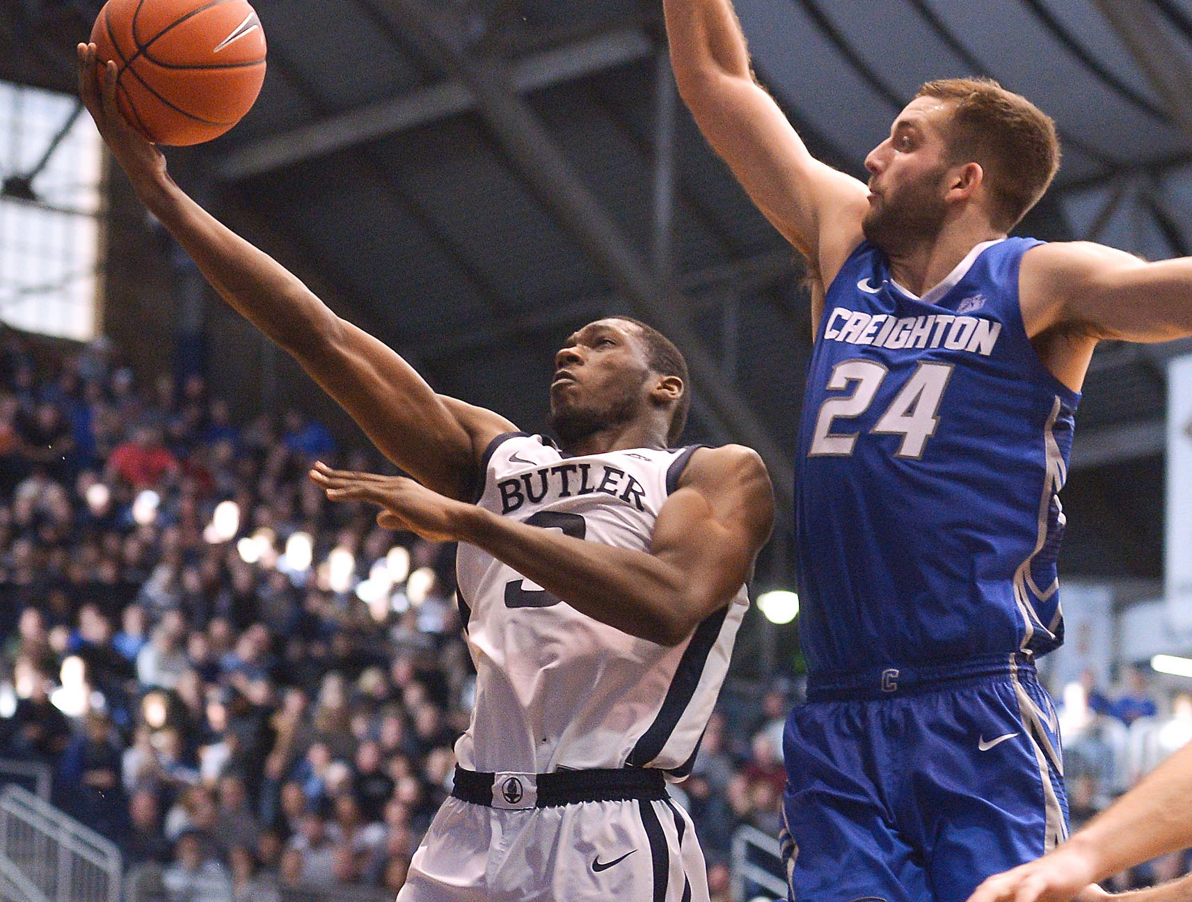 Butler Bulldogs guard Kamar Baldwin (3) scores over Creighton Bluejays guard Mitch Ballock (24) during the second half of game action between Butler University and Creighton University, at Hinkle Fieldhouse in Indianapolis, Indiana on Saturday, Jan. 5, 2019. The Butler Bulldogs defeated the Creighton Bluejays 84-69.