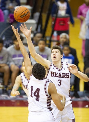 FILE – Lawrence Central senior Jake Laravia (3) scored 33 points in Friday's win over HSE.