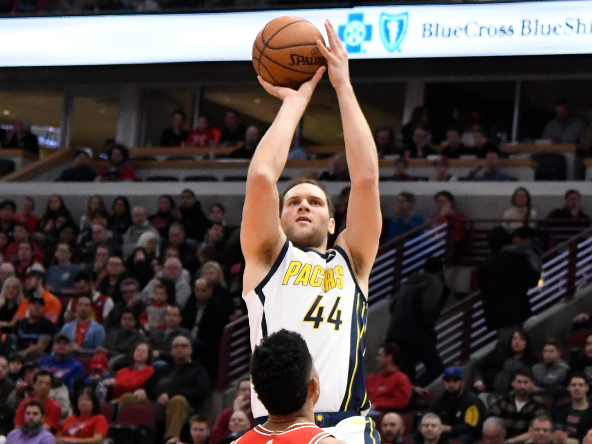 Pacers forward Bojan Bogdanovic (44) shoots over Chicago Bulls forward Chandler Hutchison (15) during the first half at United Center.