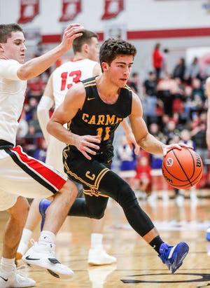 Carmel High School's Luke Heady (11), drives past ? during a game between Center Grove High School and Carmel High School, held at Center Grove on on Friday, Jan. 4, 2019.