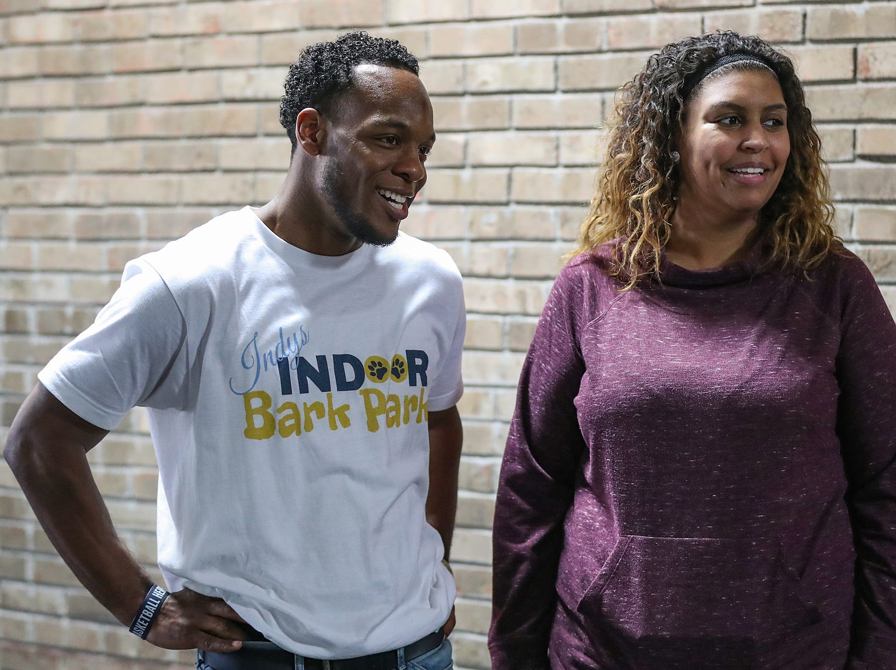 At left, owner Darius Smith talks with guests during the grand opening of Indy's Indoor Bark Park in Indianapolis, Saturday, Jan, 5, 2019. The large indoor space offers owners a place to exercise their dogs regardless of the weather. Membership options include single-day, multi-day and annual passes.