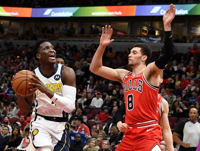 Pacers guard Victor Oladipo (4) drives to the basket while defended by Chicago Bulls guard MarShon Brooks (8) during the first half at United Center.