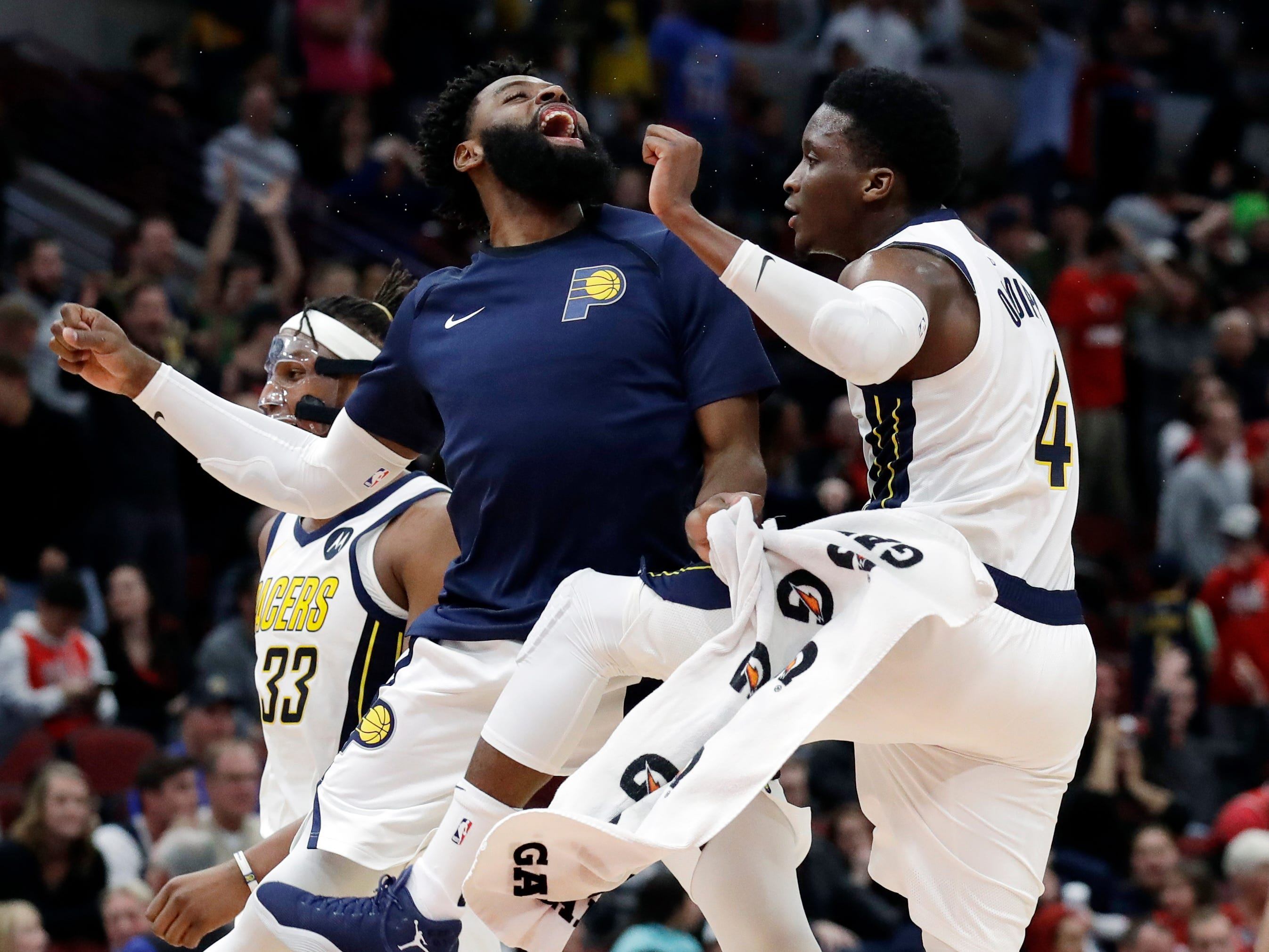 Indiana Pacers guard Victor Oladipo, right, celebrates with guard Tyreke Evans after he made a three-point basket against the Chicago Bulls during overtime of an NBA basketball game Friday, Jan. 4, 2019, in Chicago. (AP Photo/Nam Y. Huh)