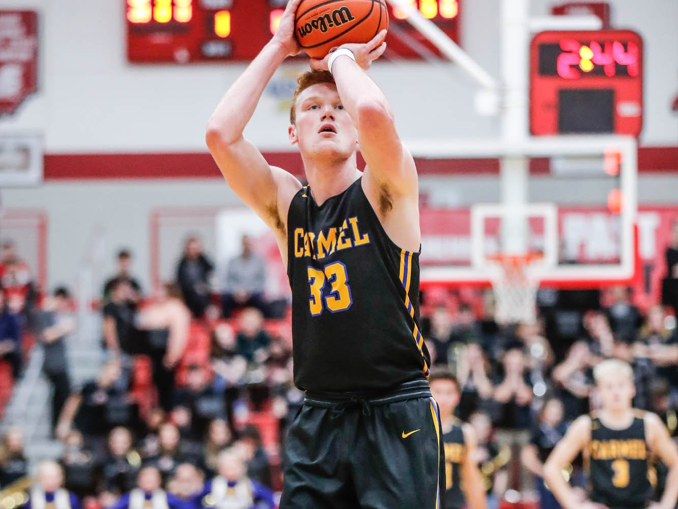 Carmel High School's John Michael Mulloy (33), shoots a free throw, during a game between Center Grove High School and Carmel High School, held at Center Grove on on Friday, Jan. 4, 2019.
