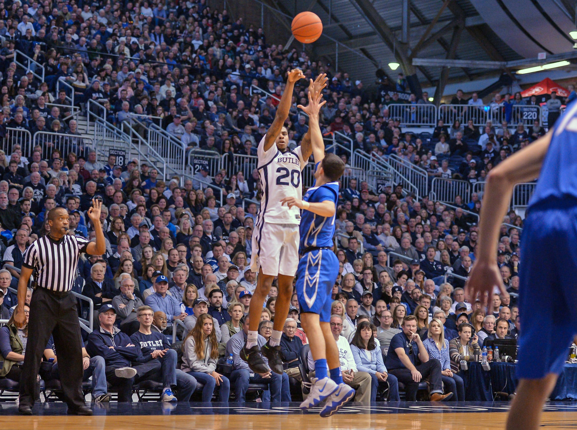 Butler Bulldogs forward Henry Baddley (20) scores a three-pointer against the Creighton Bluejays during the first half of game action between Butler University and Creighton University, at Hinkle Fieldhouse in Indianapolis, Indiana on Saturday, Jan. 5, 2019.