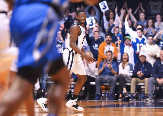 Butler Bulldogs guard Kamar Baldwin (3) is celebrated after hitting a three-pointer against the Creighton Bluejays during the second half of game action between Butler University and Creighton University, at Hinkle Fieldhouse in Indianapolis, Indiana on Saturday, Jan. 5, 2019. The Butler Bulldogs defeated the Creighton Bluejays 84-69.