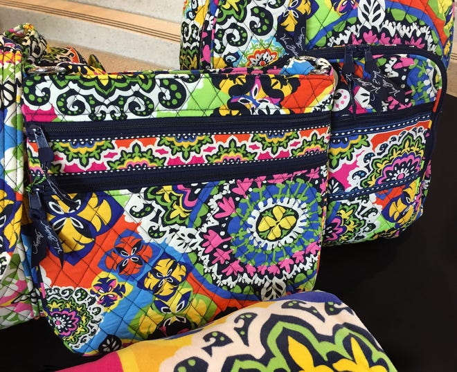 """Vera Bradley handbags with the """"Rio"""" pattern are shown on Monday, July 27, 2015. Rio is one of Indiana-based company's patterns released as part of its 2015 spring collection."""