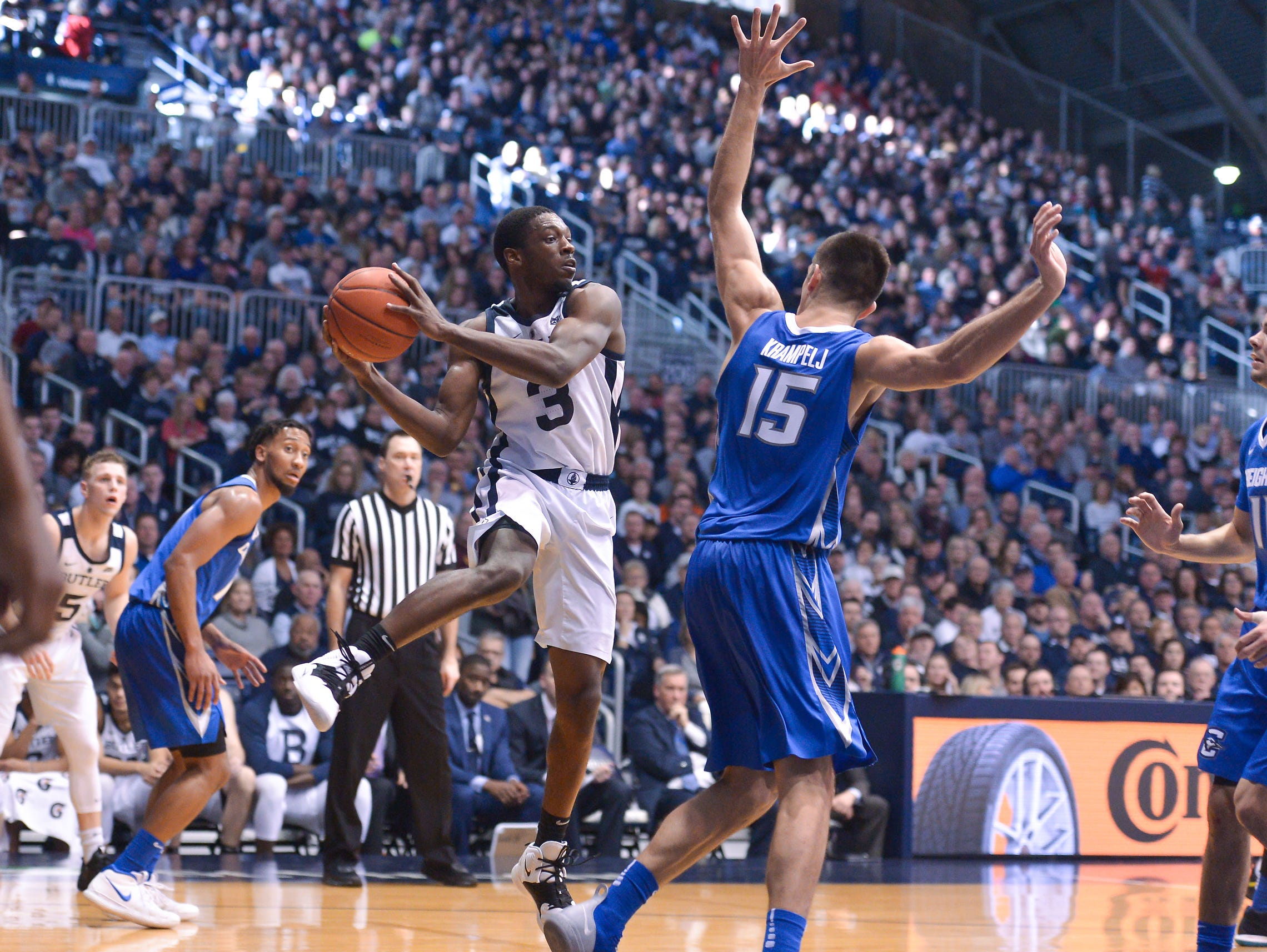 Butler Bulldogs guard Kamar Baldwin (3) passes the ball against Creighton Bluejays forward Martin Krampelj (15) during the second half of game action between Butler University and Creighton University, at Hinkle Fieldhouse in Indianapolis, Indiana on Saturday, Jan. 5, 2019. The Butler Bulldogs defeated the Creighton Bluejays 84-69.