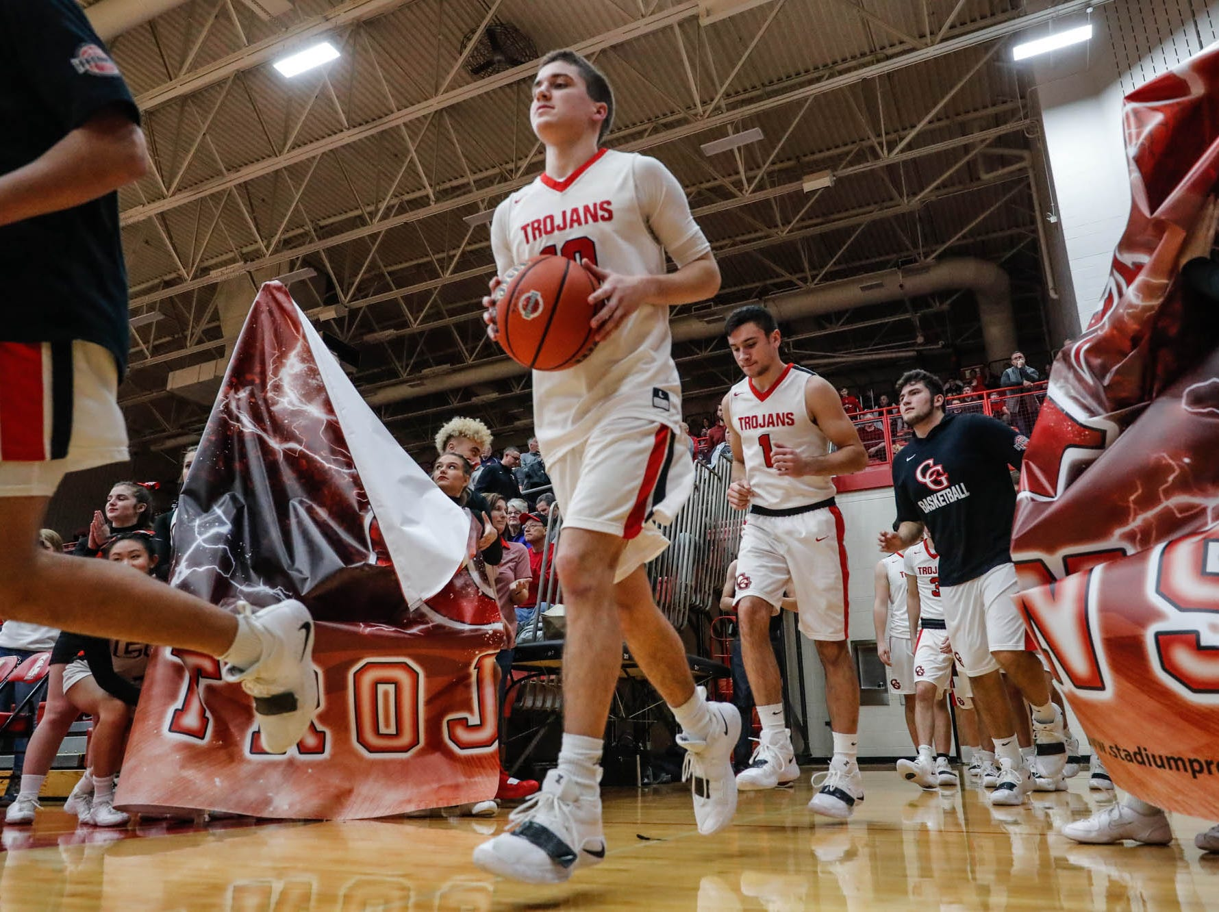 FILE – Center Grove basketball advanced to the sectional semifinals with a hard-fought win over Greenwood on Tuesday.