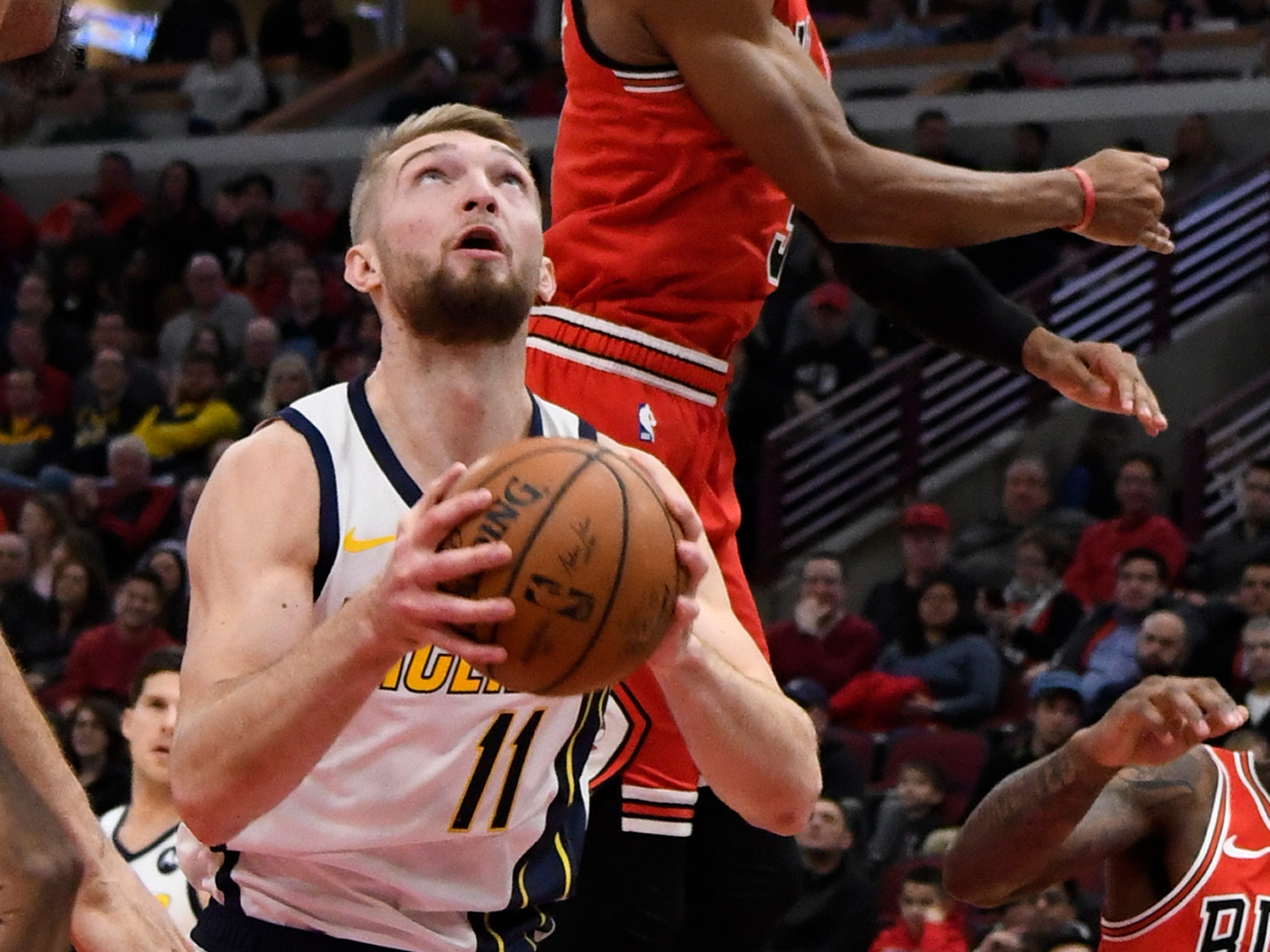 Pacers forward Domantas Sabonis (11) attempts a shot defended by Chicago Bulls guard Shaquille Harrison (3) during the first half at United Center.