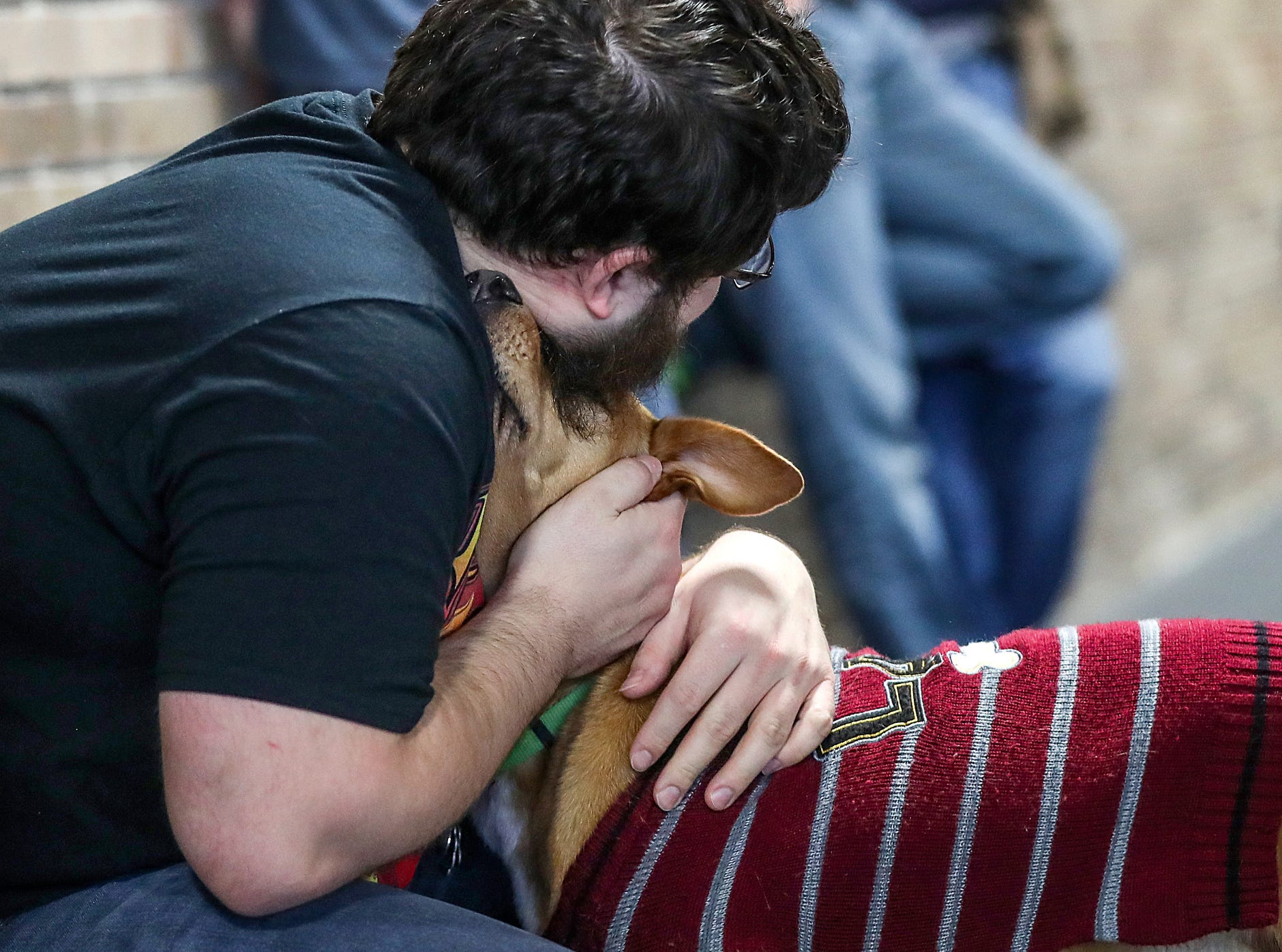 Owner Alex Toll hugs his dog Layla during the grand opening of Indy's Indoor Bark Park in Indianapolis, Saturday, Jan, 5, 2019. The large indoor space offers owners a place to exercise their dogs regardless of the weather. Membership options include single-day, multi-day and annual passes.